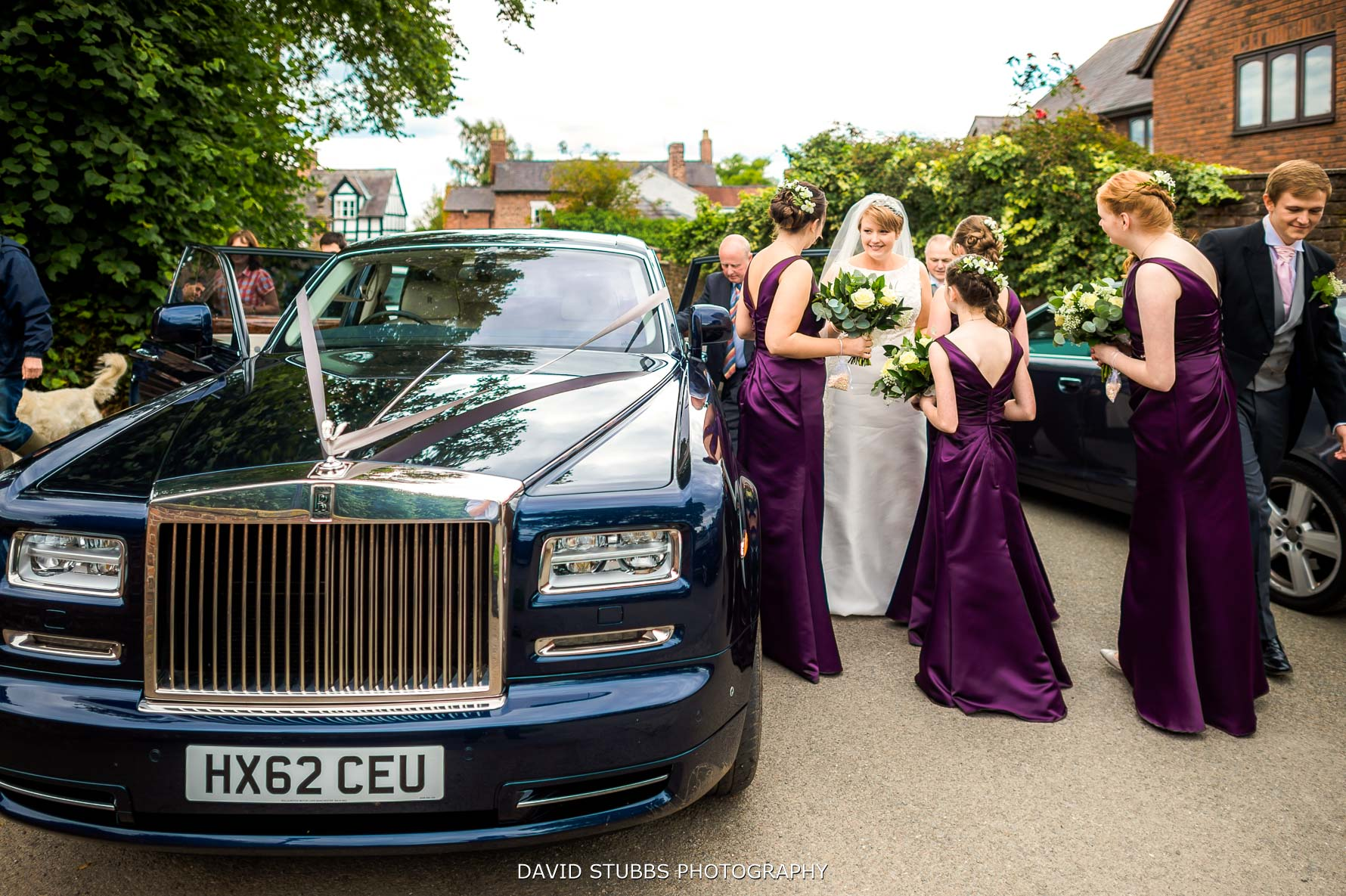 wedding car arriving with the bridal party