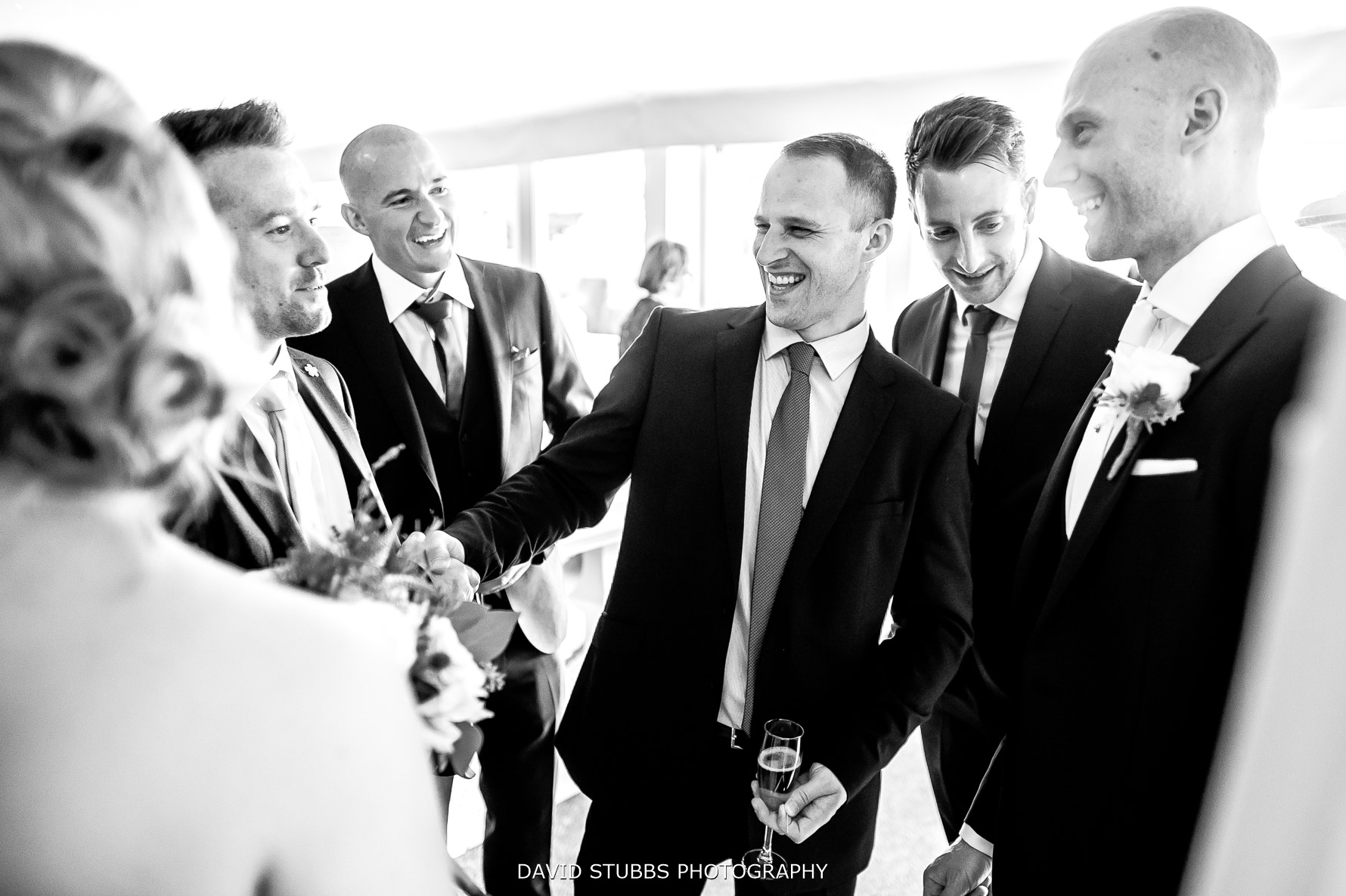lads all gathering around the groom