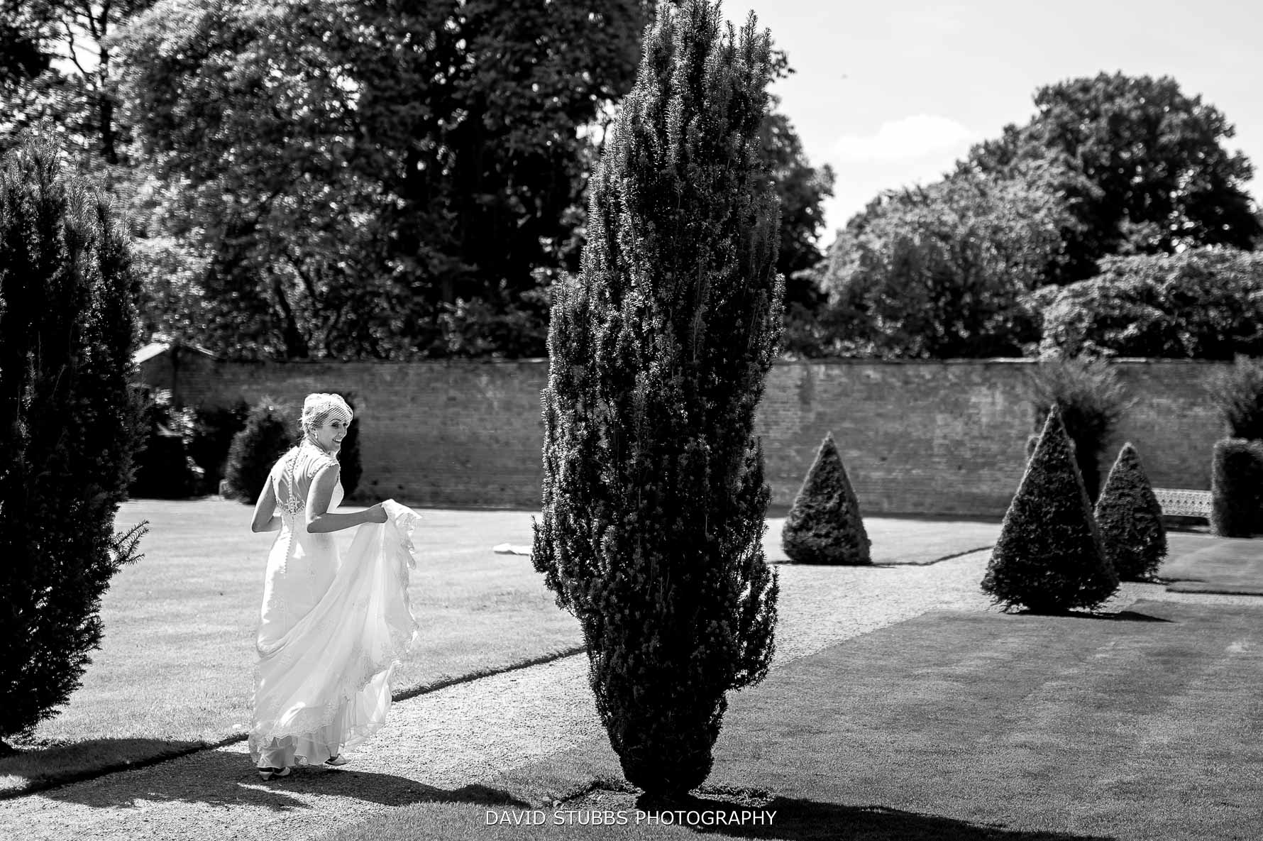bride walking along the path at combermere