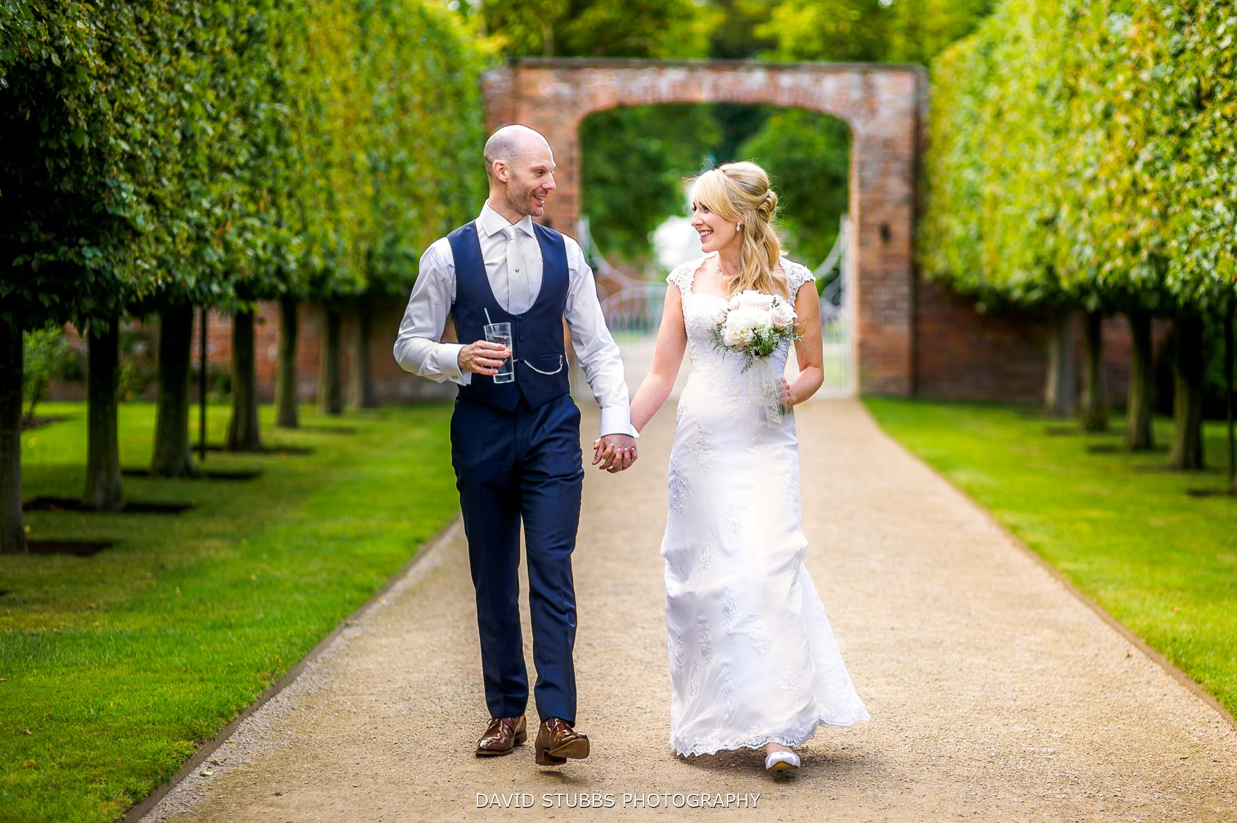 natural photo of the newlyweds at combermere abbey wedding