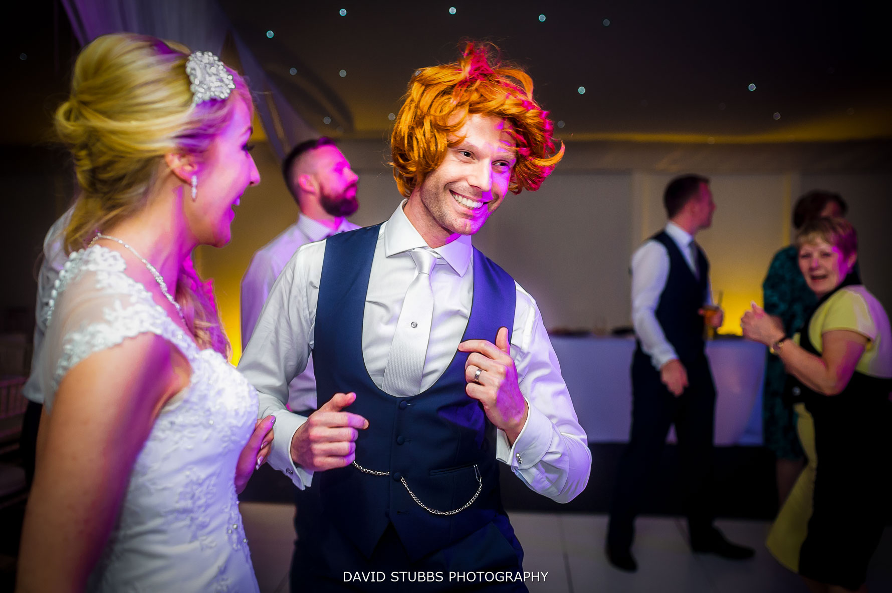 groom with a silly wig on