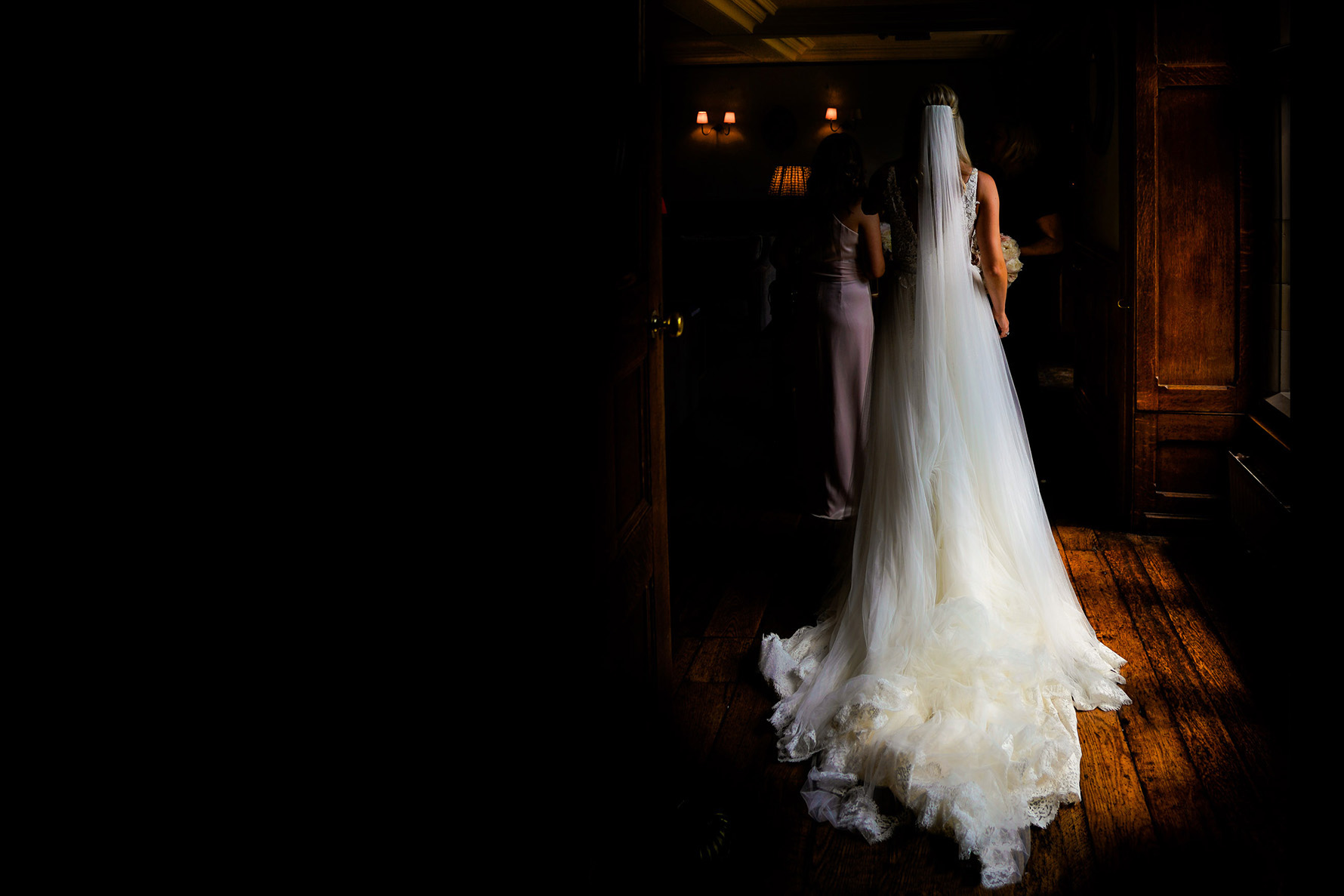 wedding dress from behind with windown light