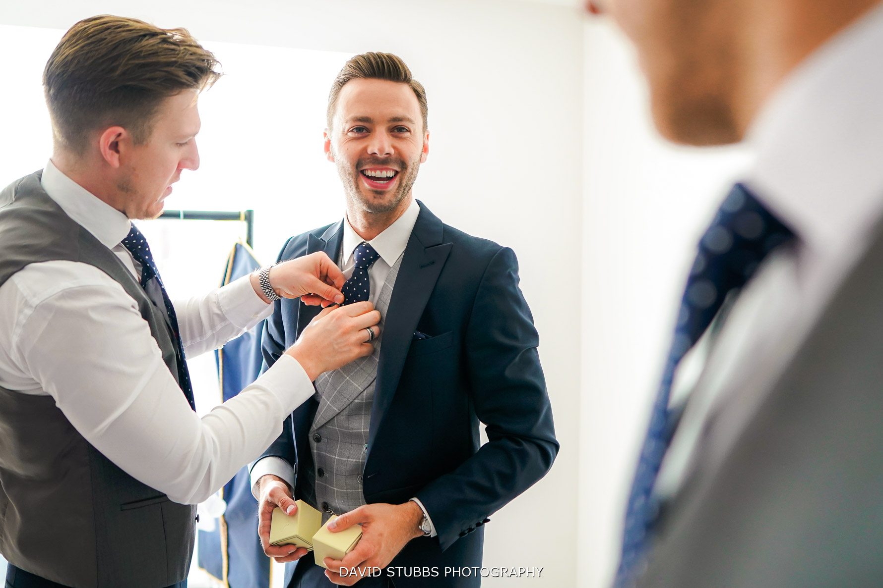groom getting his sharp suit on