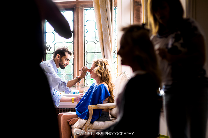 woman having make-up done