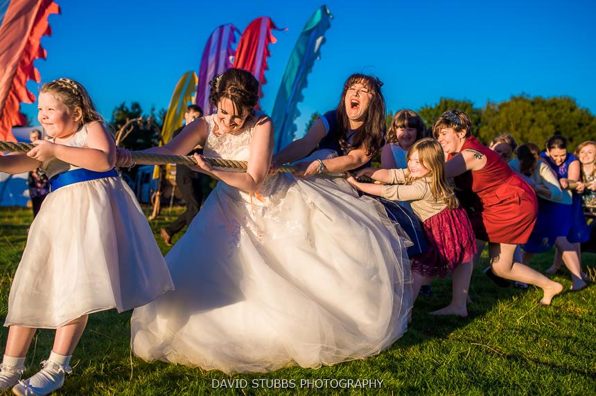 girls win tug of war woodland wedding