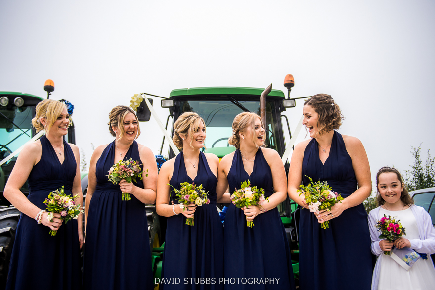 bridesmaids next to tractor