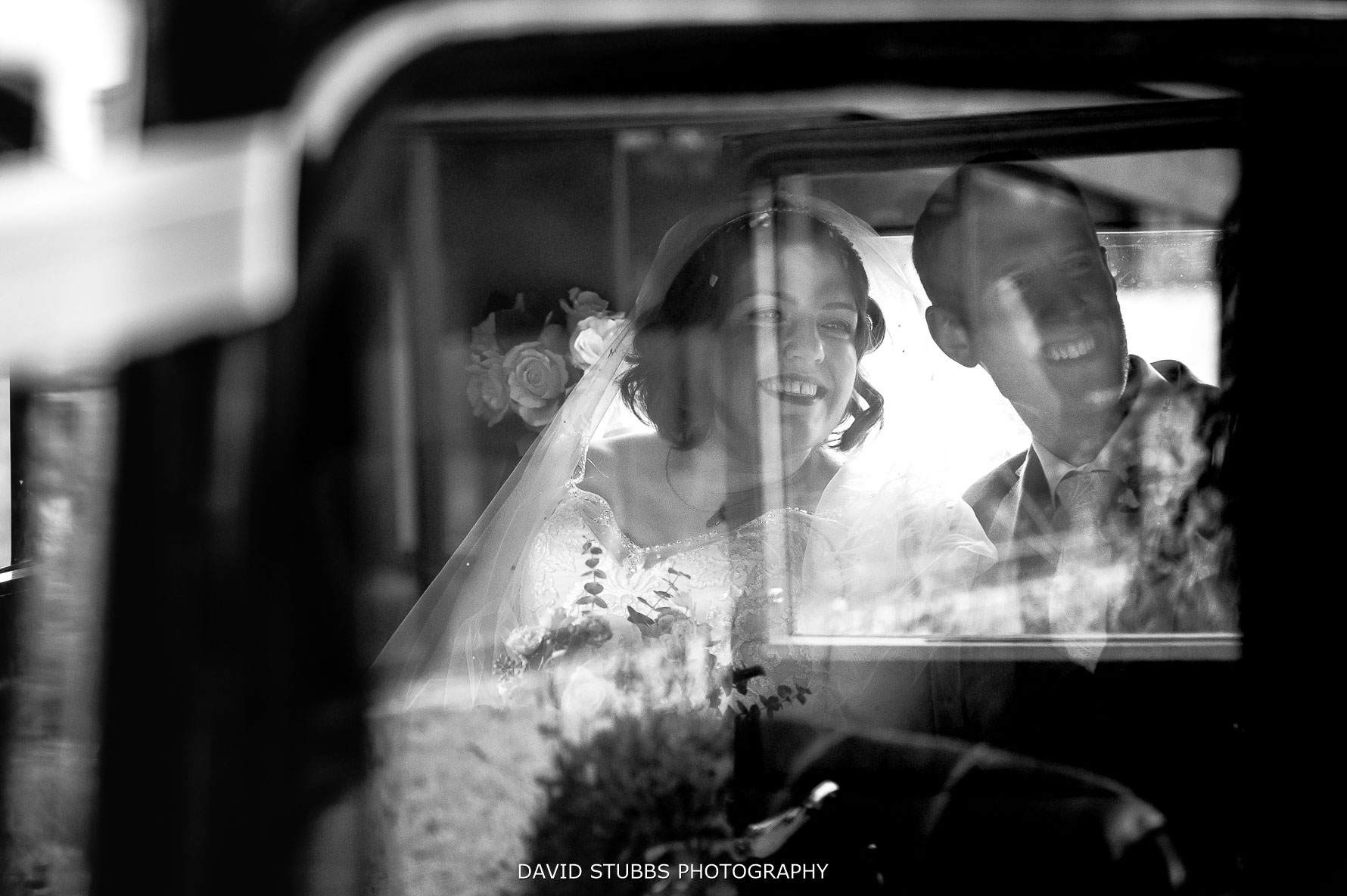 black and white photo in the wedding car