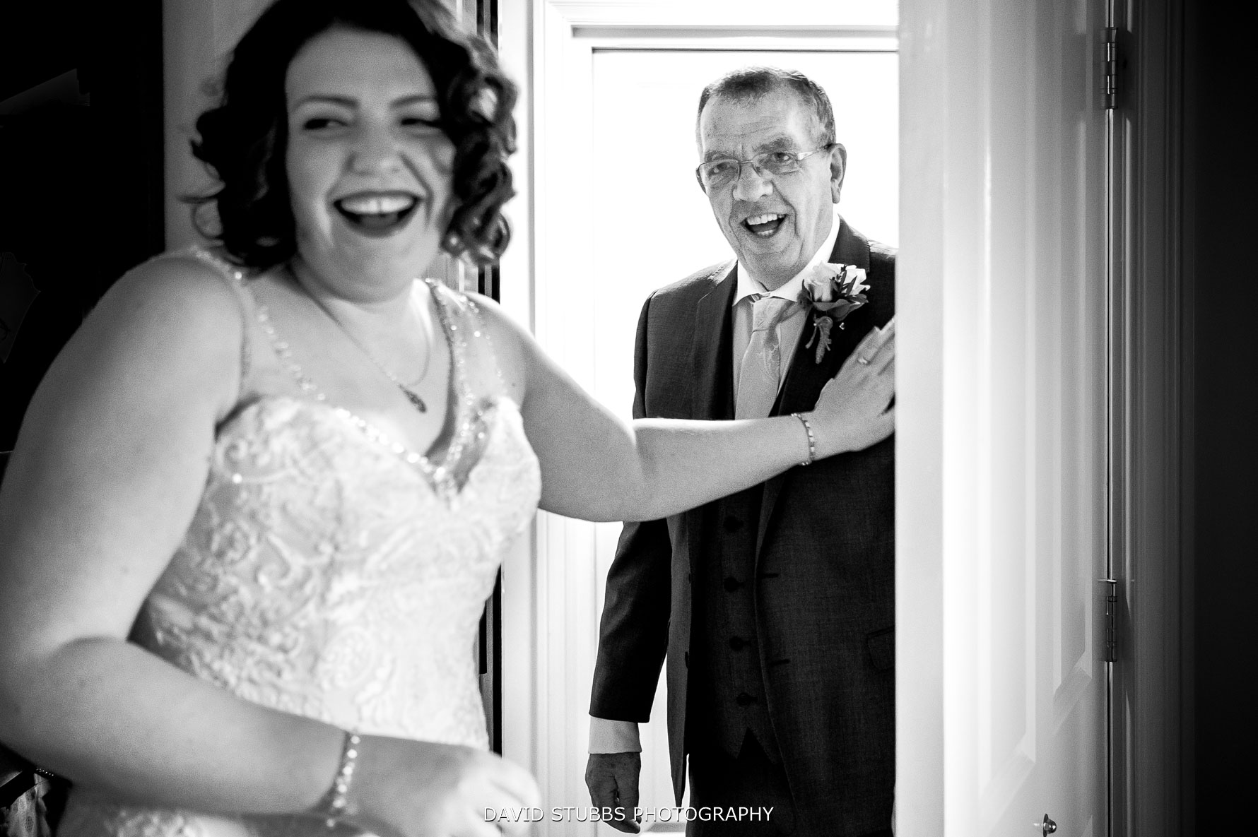 father of the bride seeing her in her wedding dress for the first time
