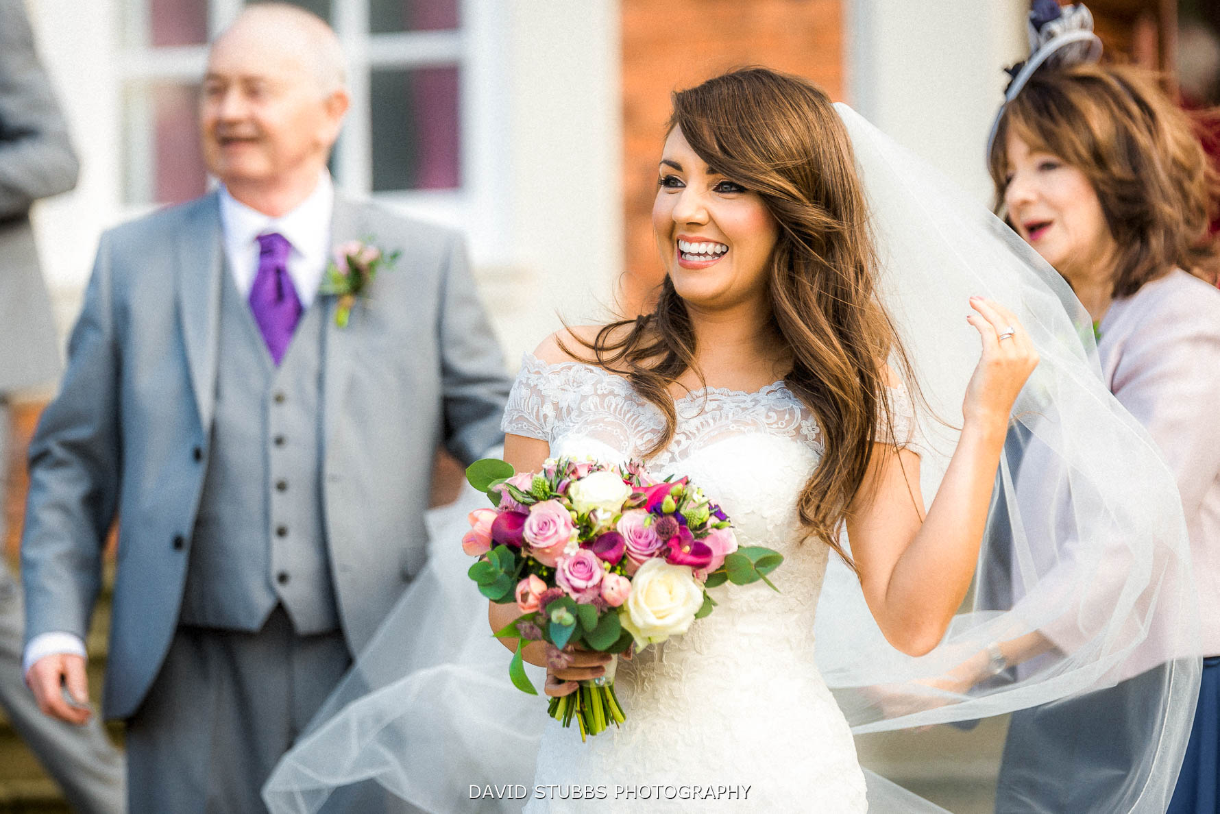 bride with veil in the wind at Knowsley hall
