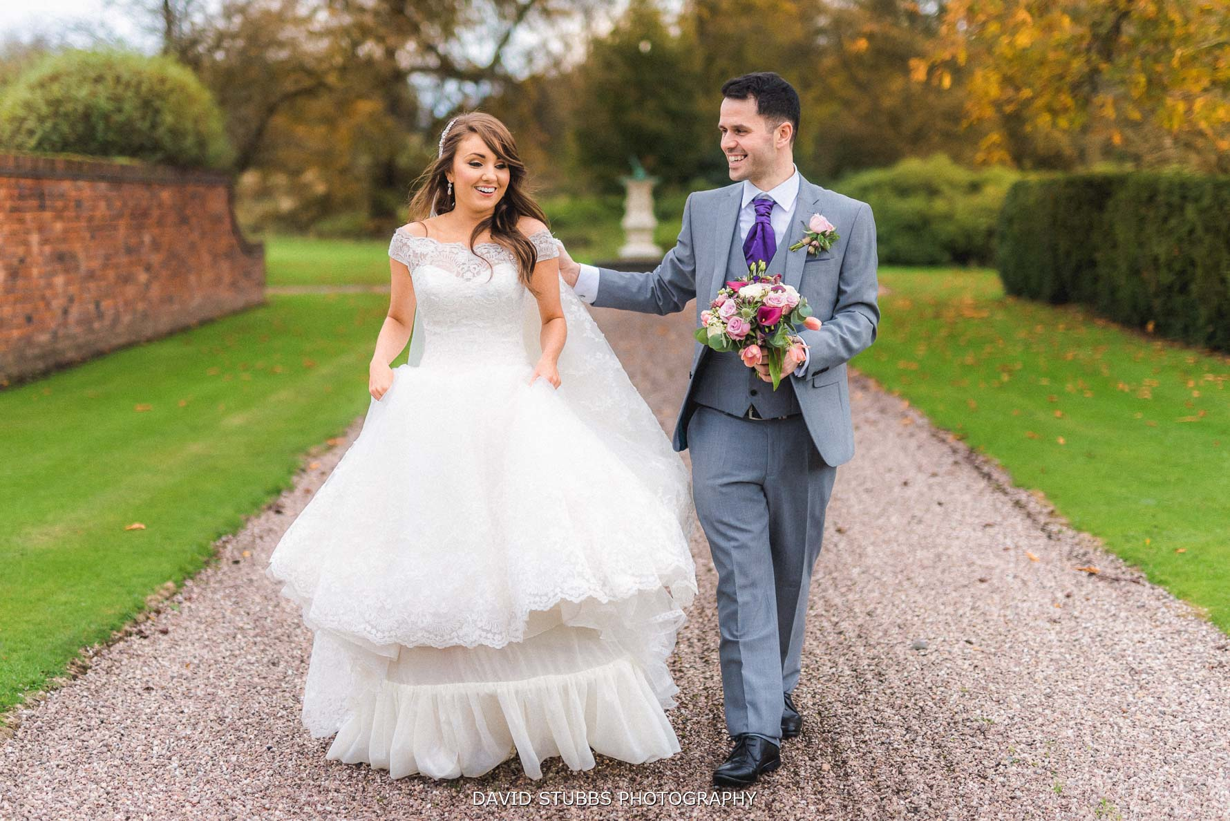 relaxed wedding photo walking along a path