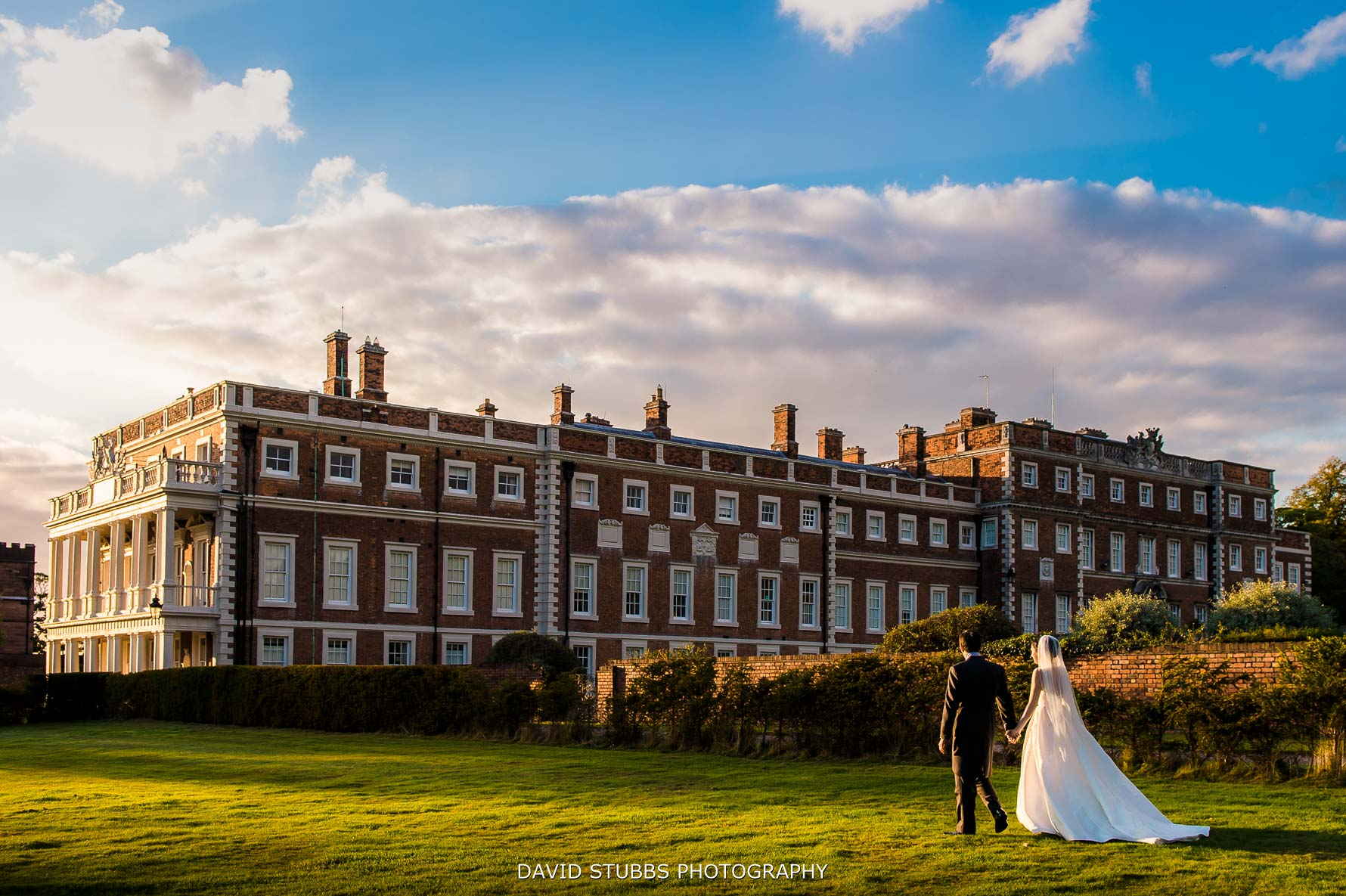 great light getting with the hall behind the newlyweds