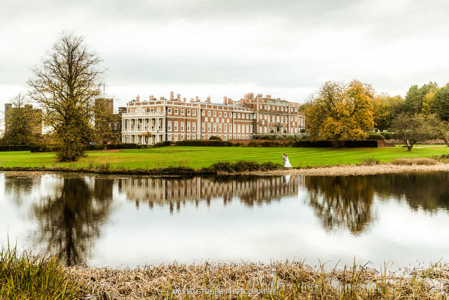 a view over the lake at their Knowsley hall wedding