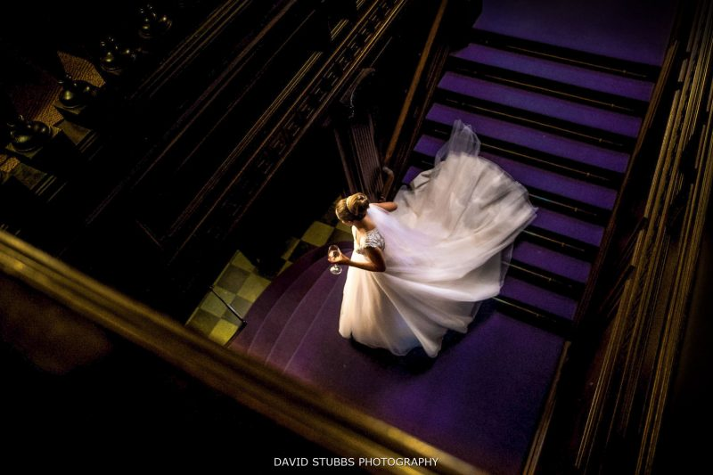 bride walking down the stairs at eaves hall wedding
