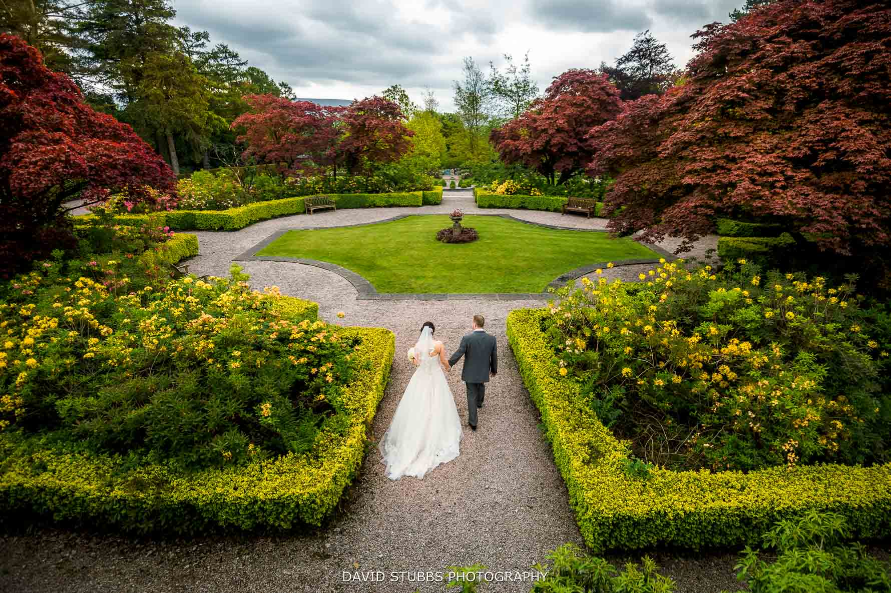 bride and groom together in gardens