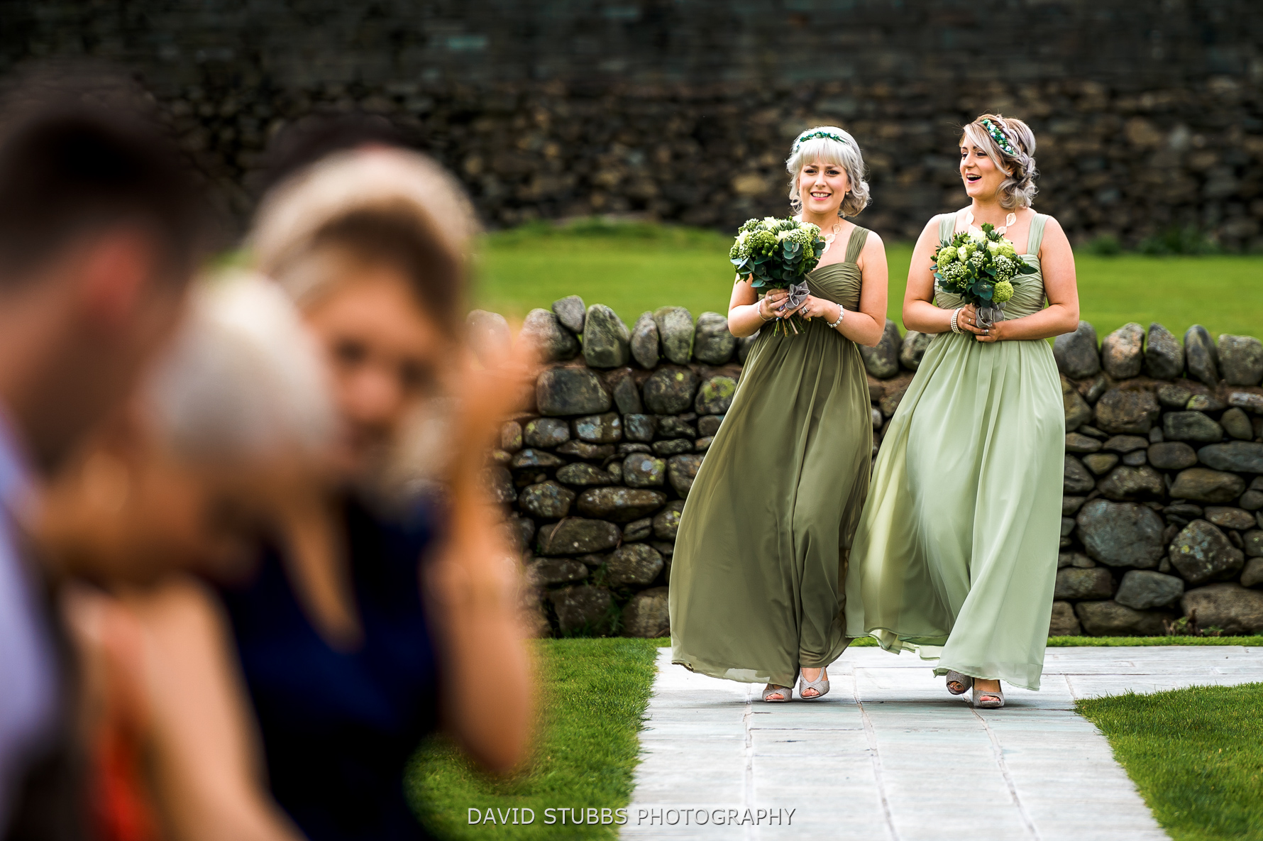 bridemaids walking down the isle