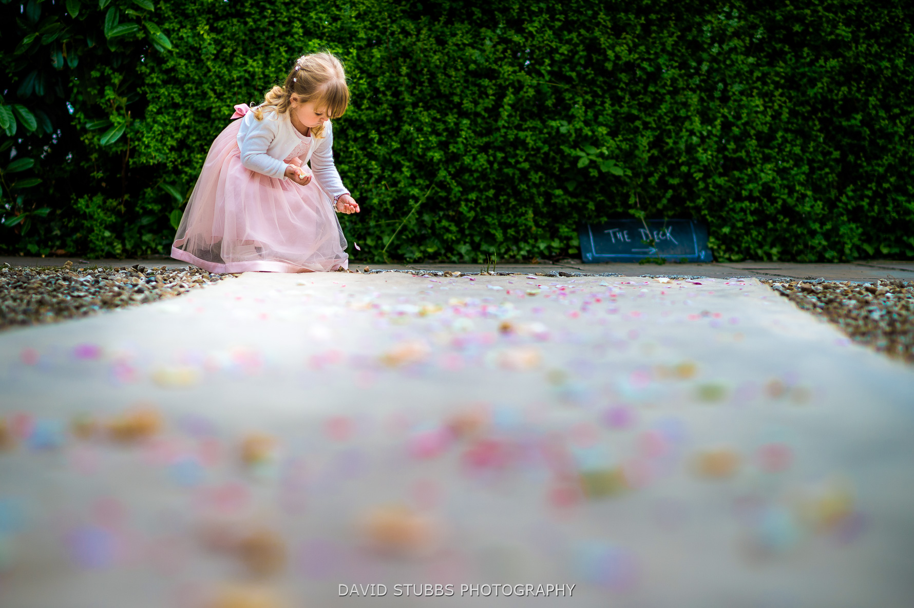 girl picking up the confetti