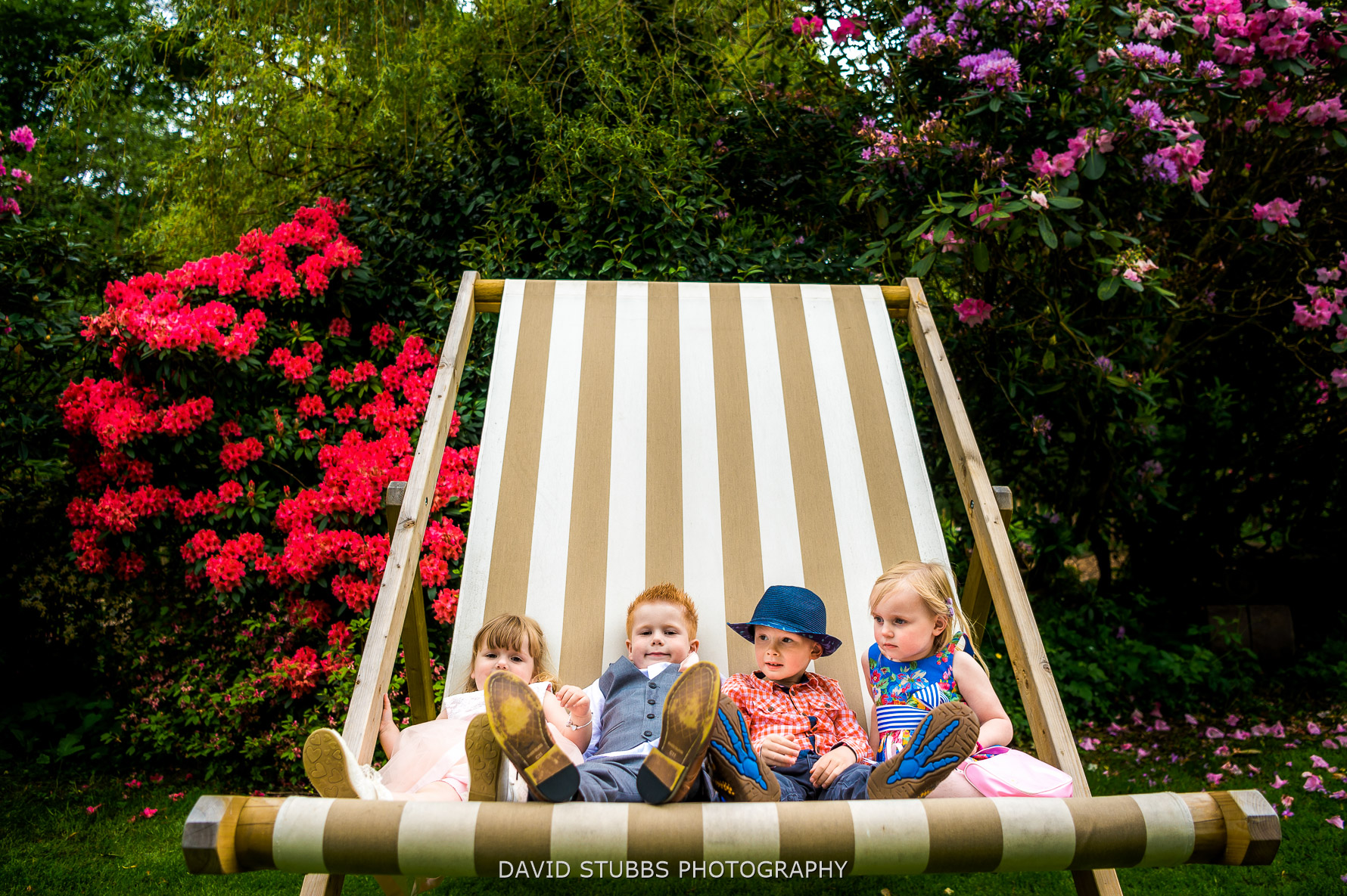 kids sat on a giant deck chair