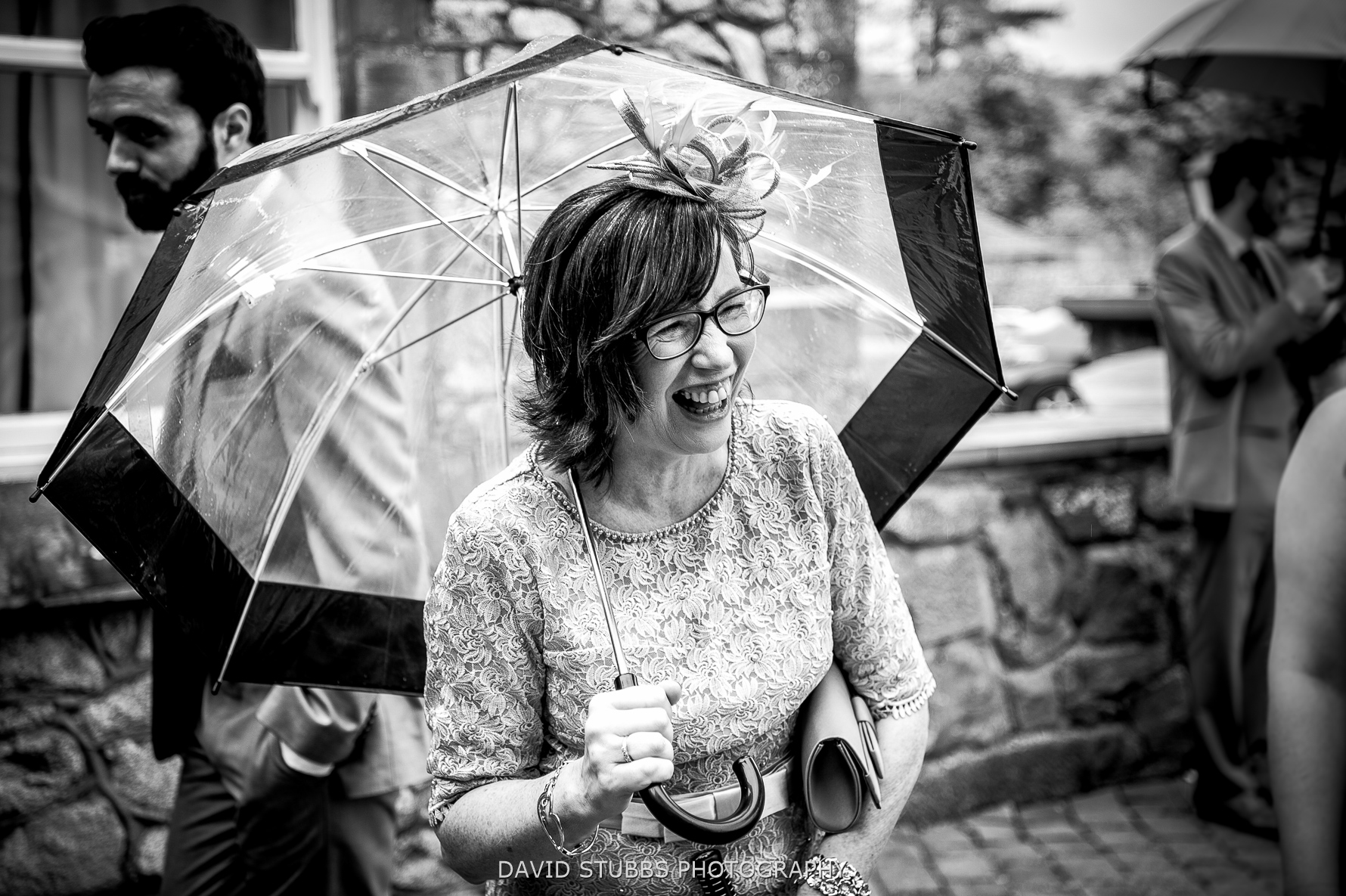 mum under umbrella in rain