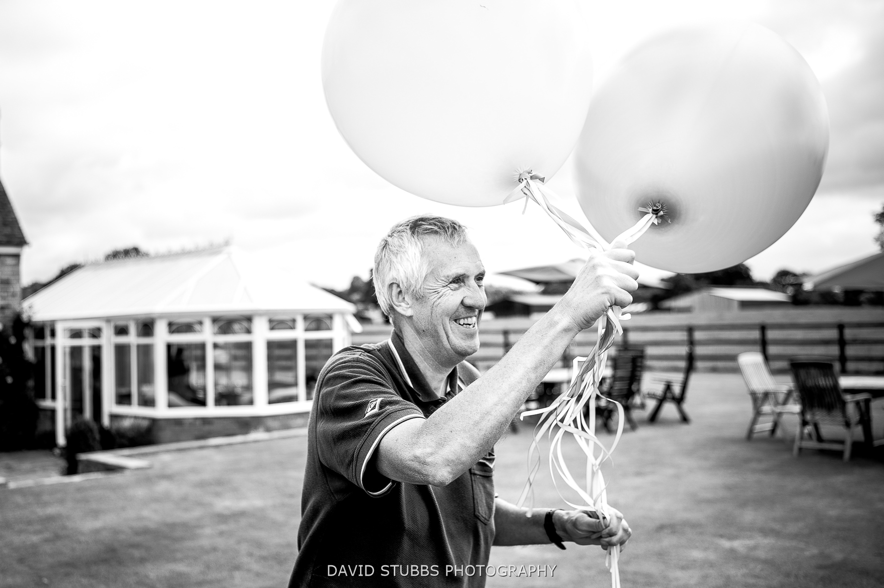 father of bride with balloons
