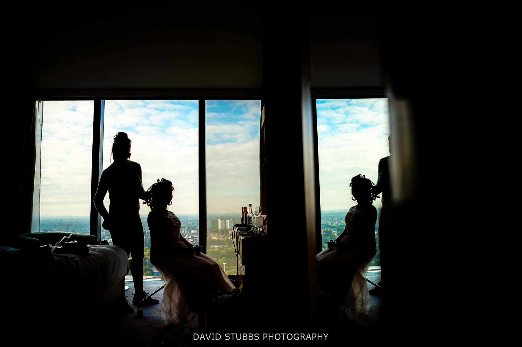 silhouette in glass window