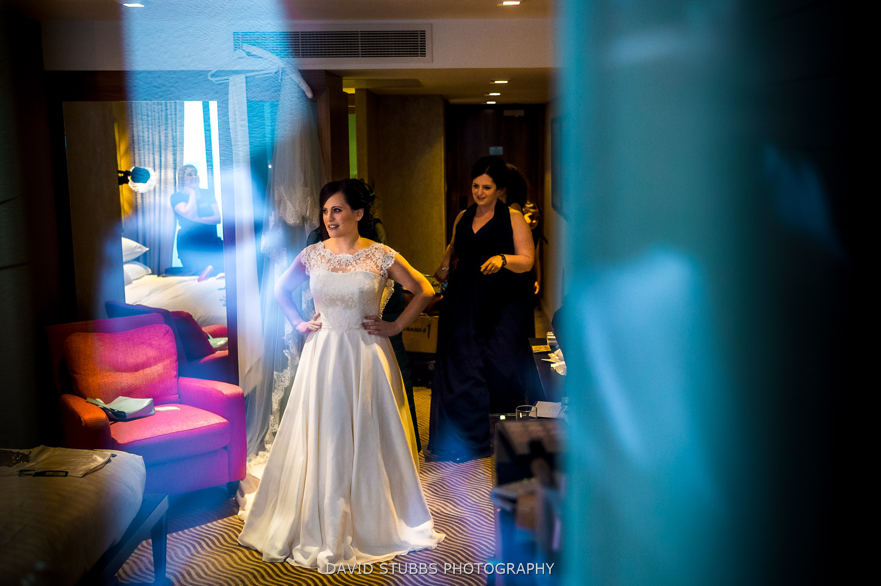 bride in wedding dress through glass