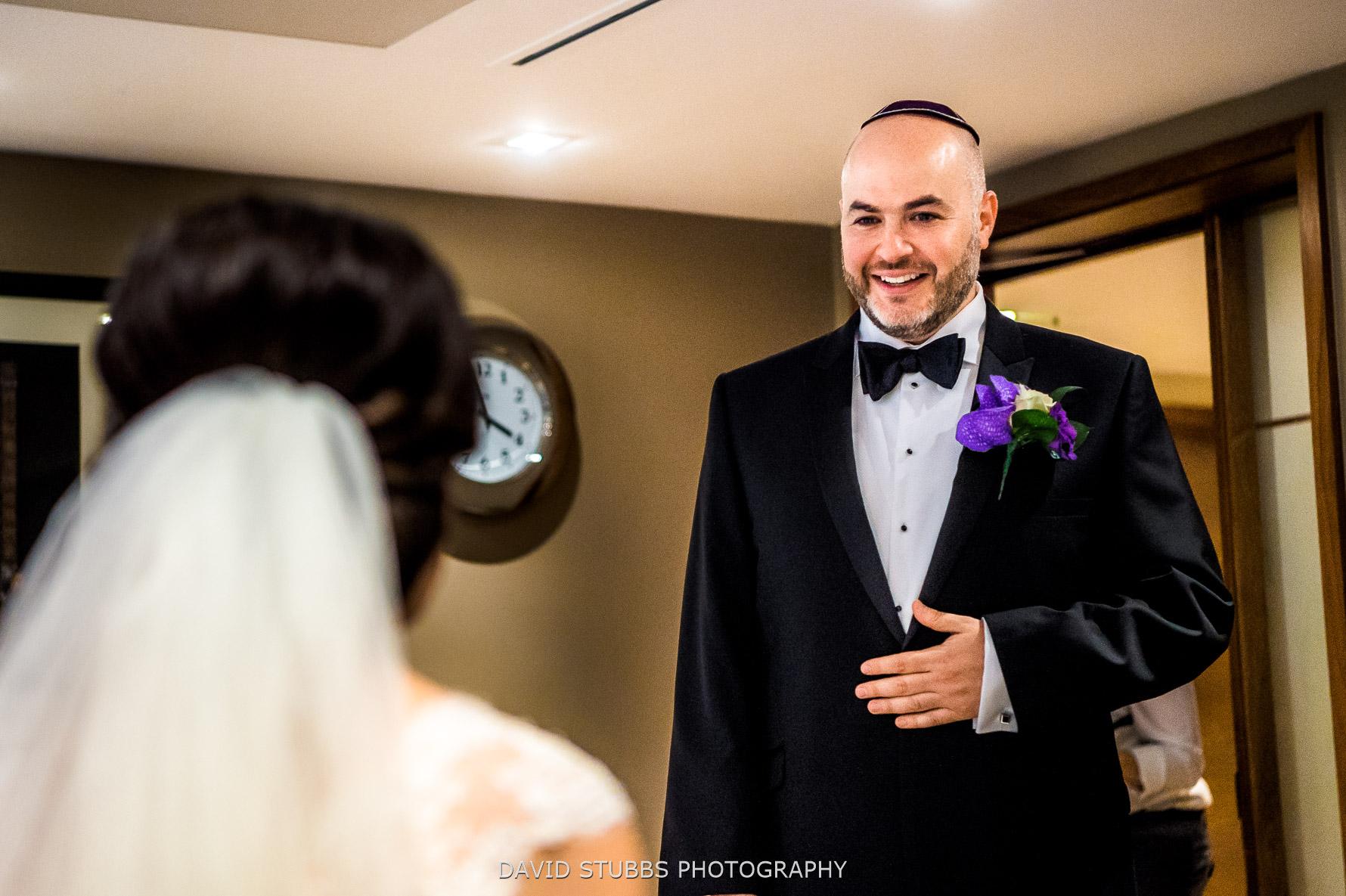 grooms sees bride