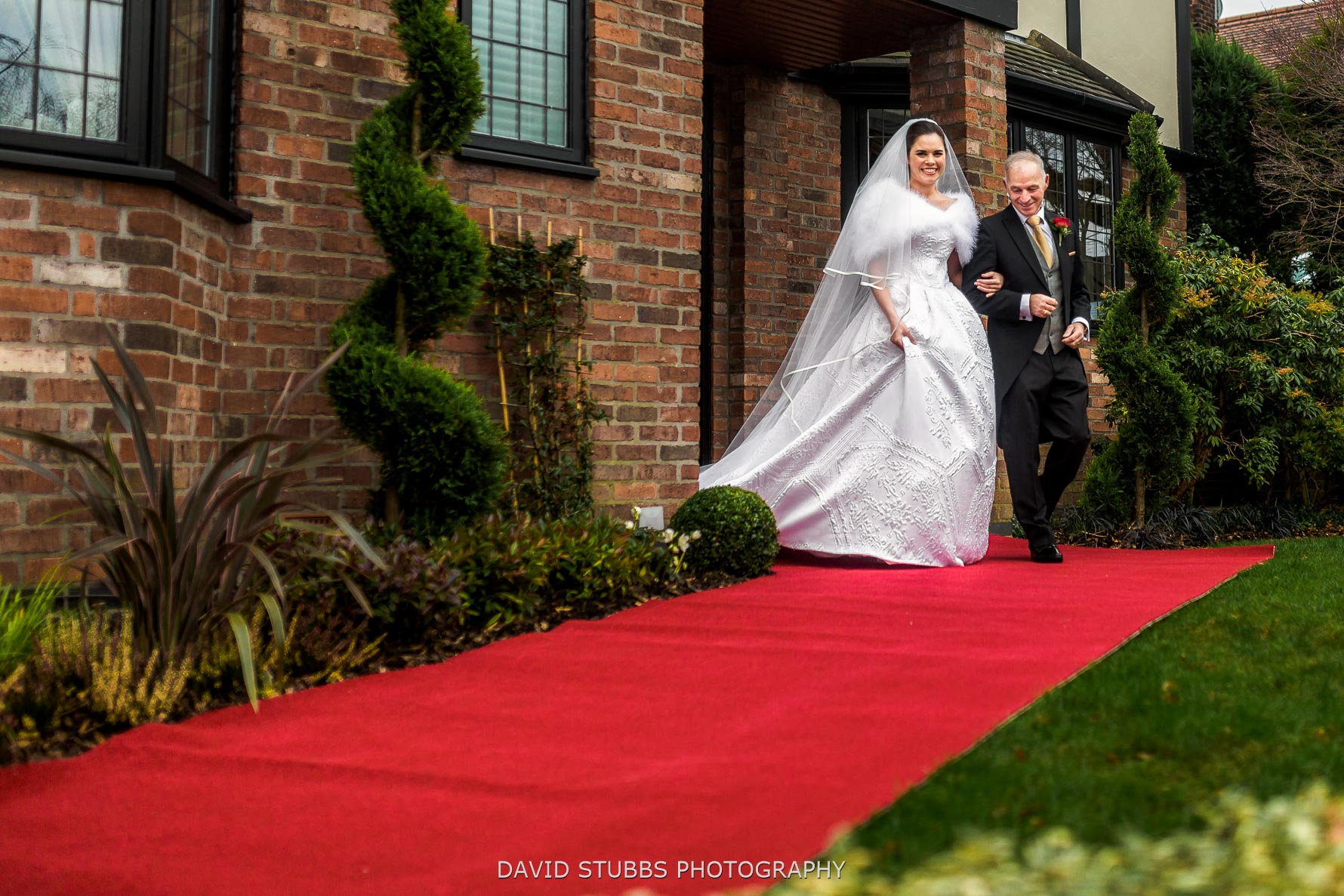 red carpet leaving house for ceremony
