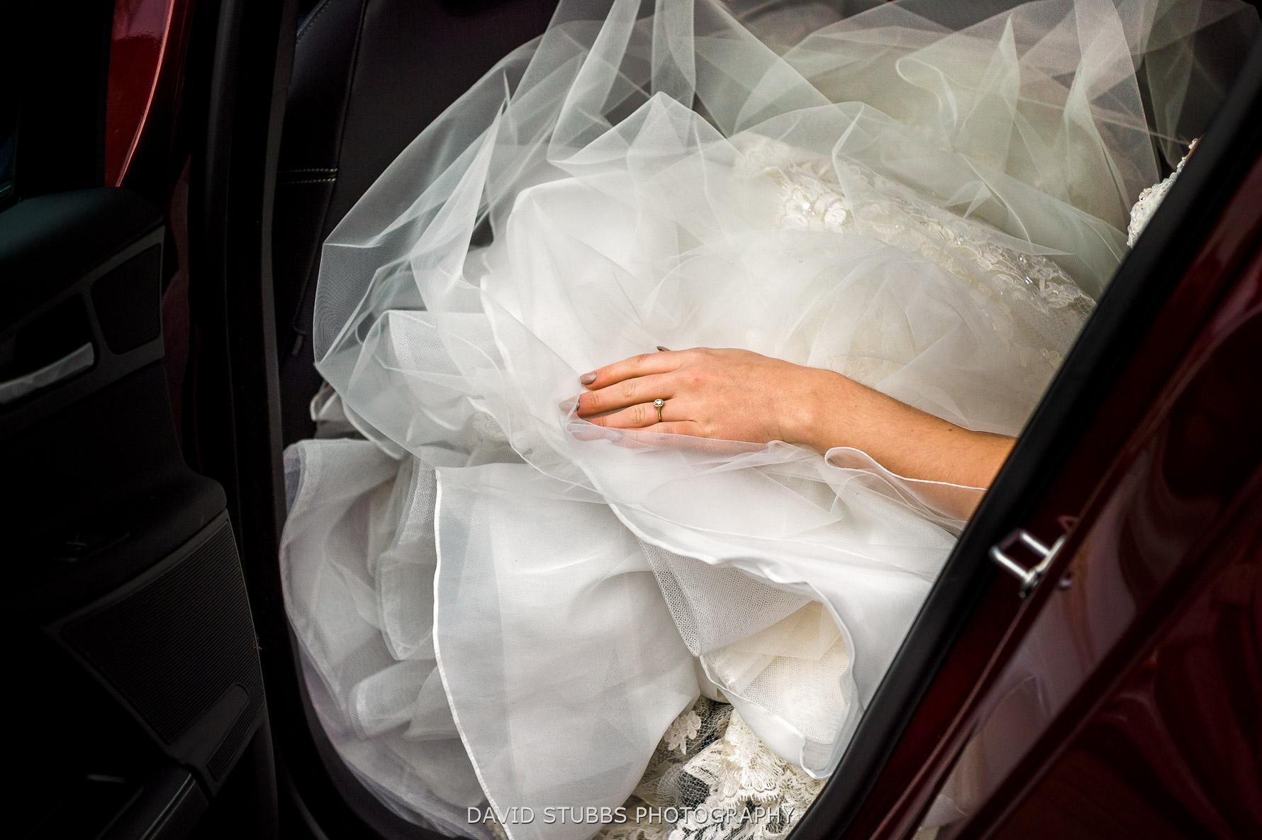 brides hand on dress