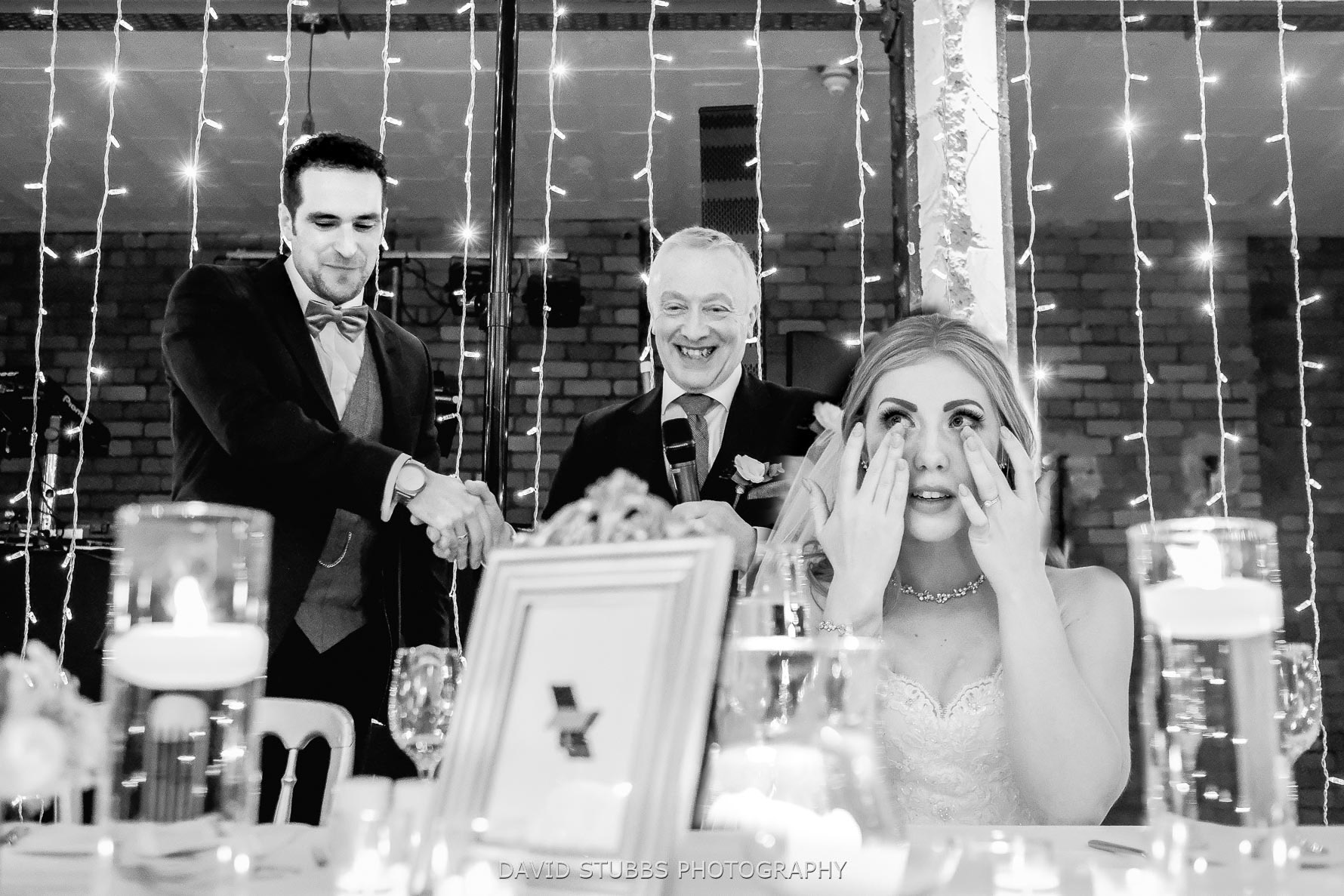 bride tears with groom and dad