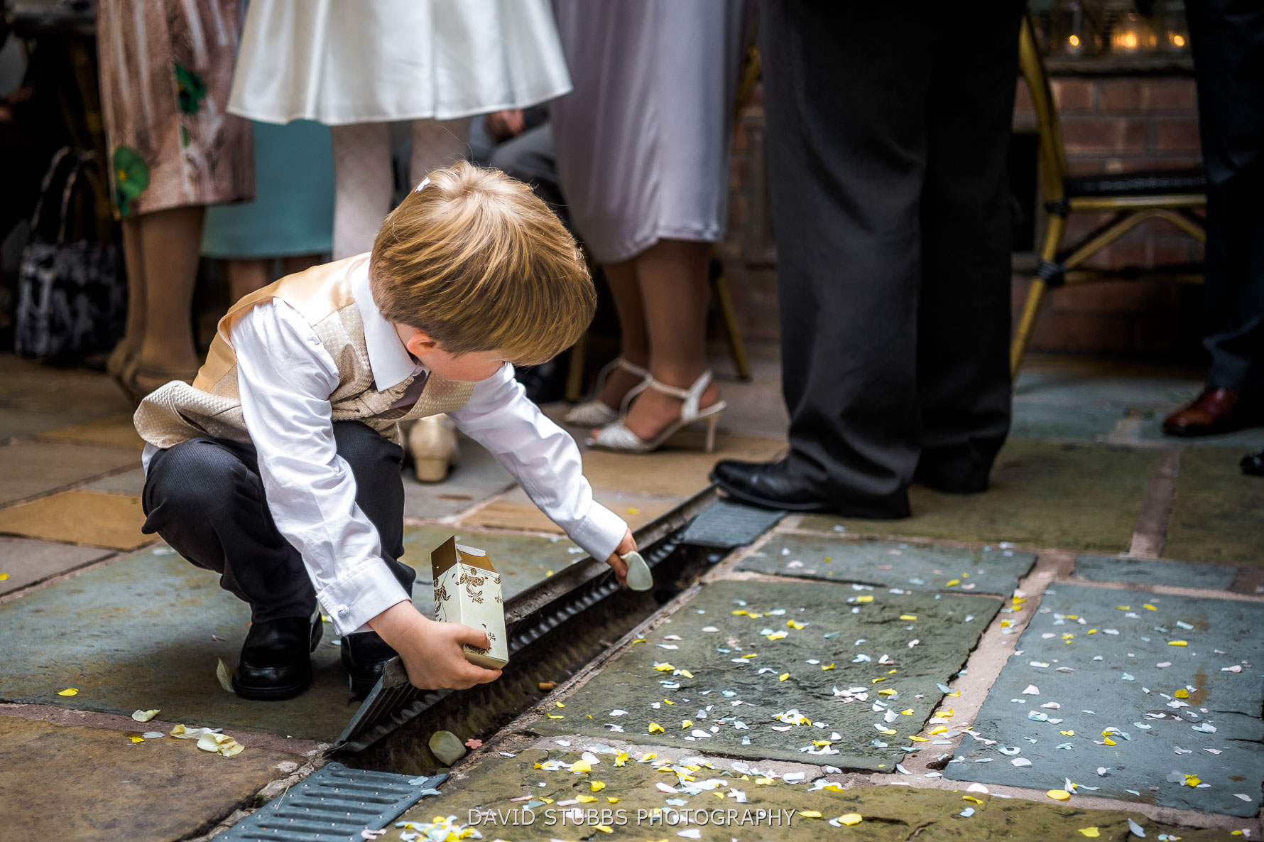 kid picking up confetti