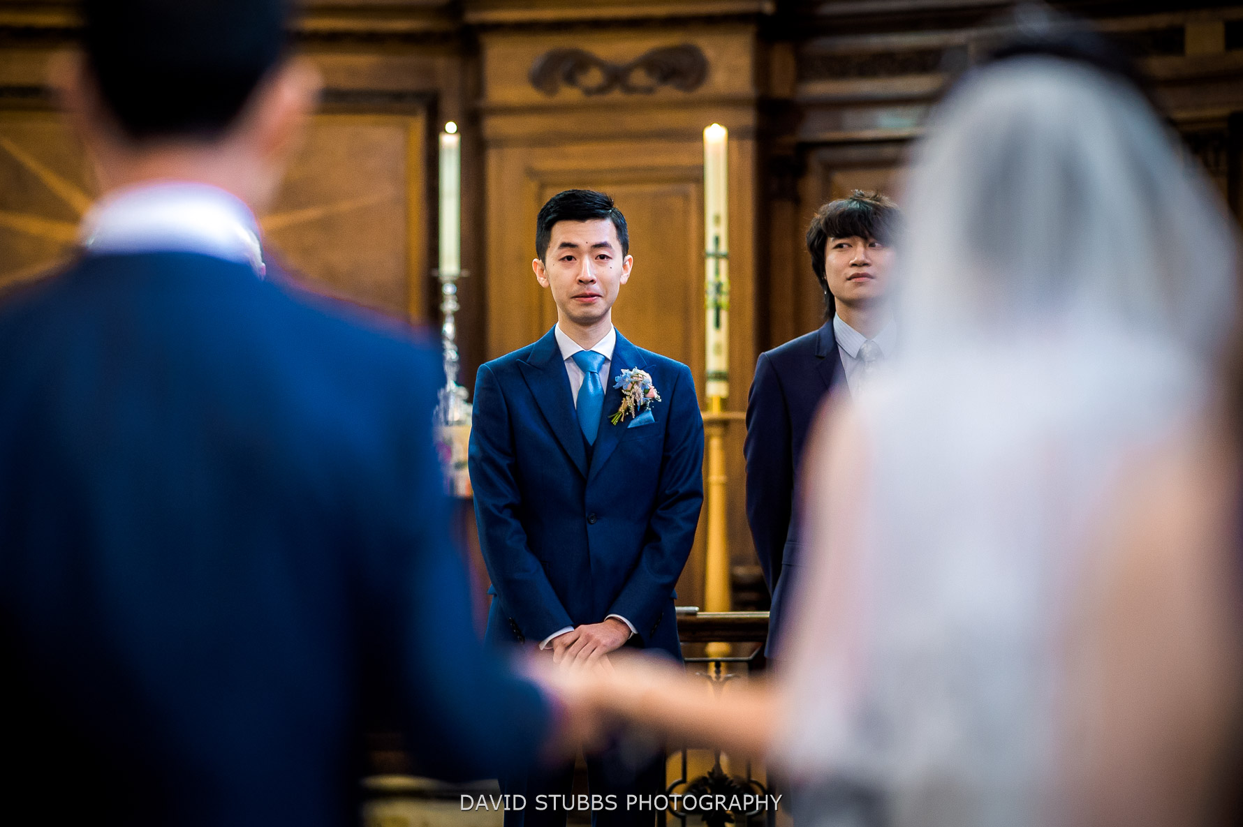 groom crying as bride walks down the isle