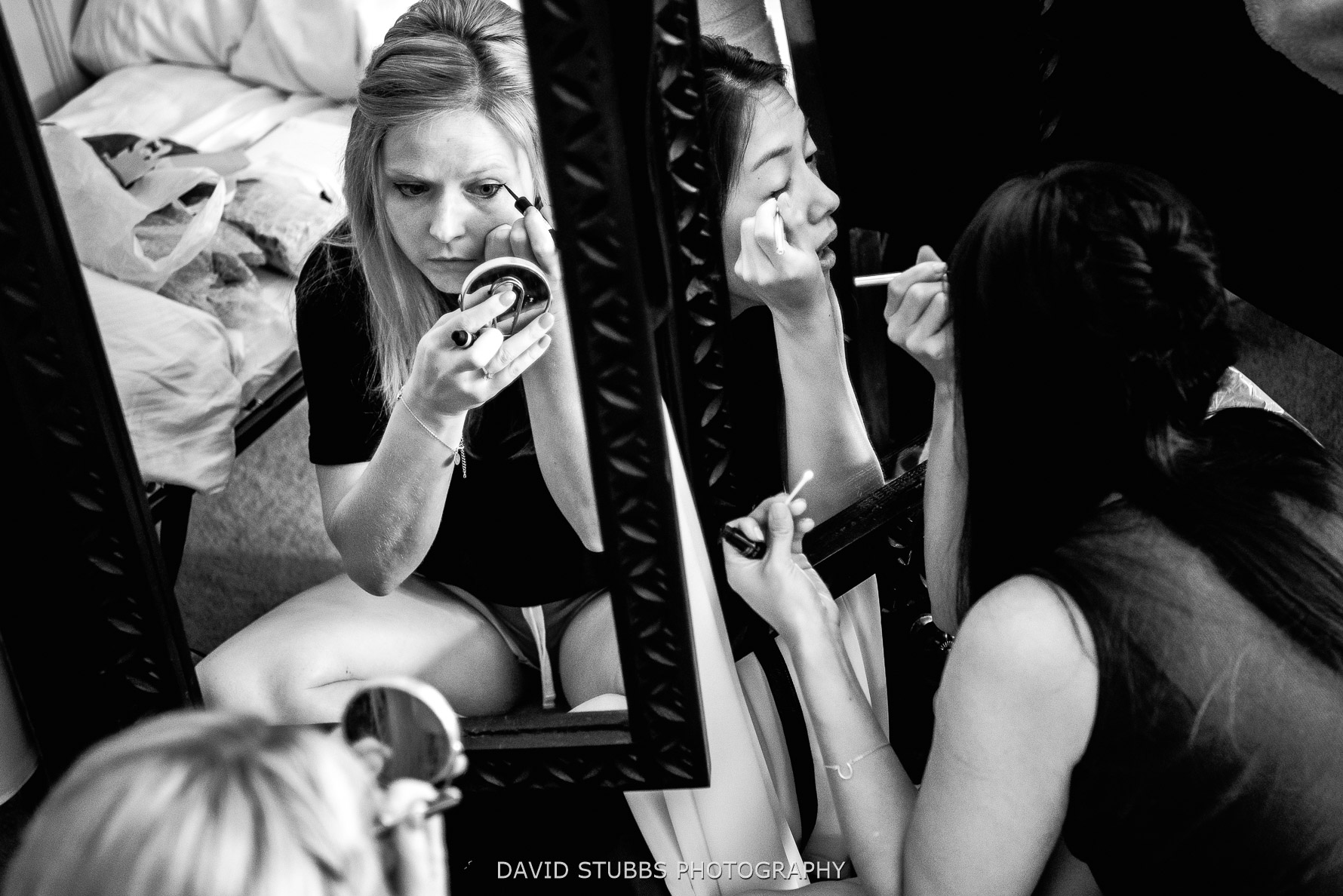 mirror reflection photo applying make-up