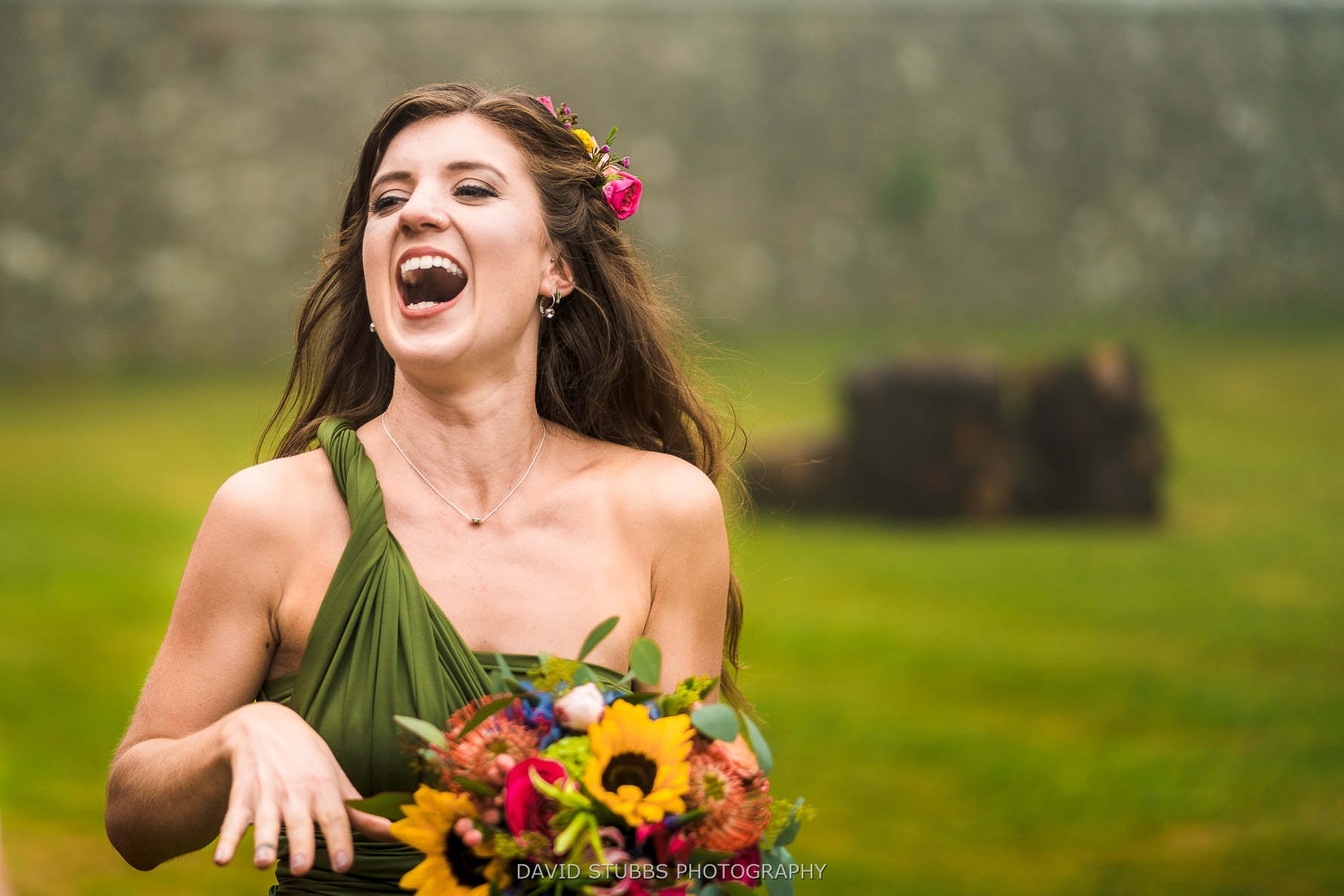 bridemaid having a good time with flowers