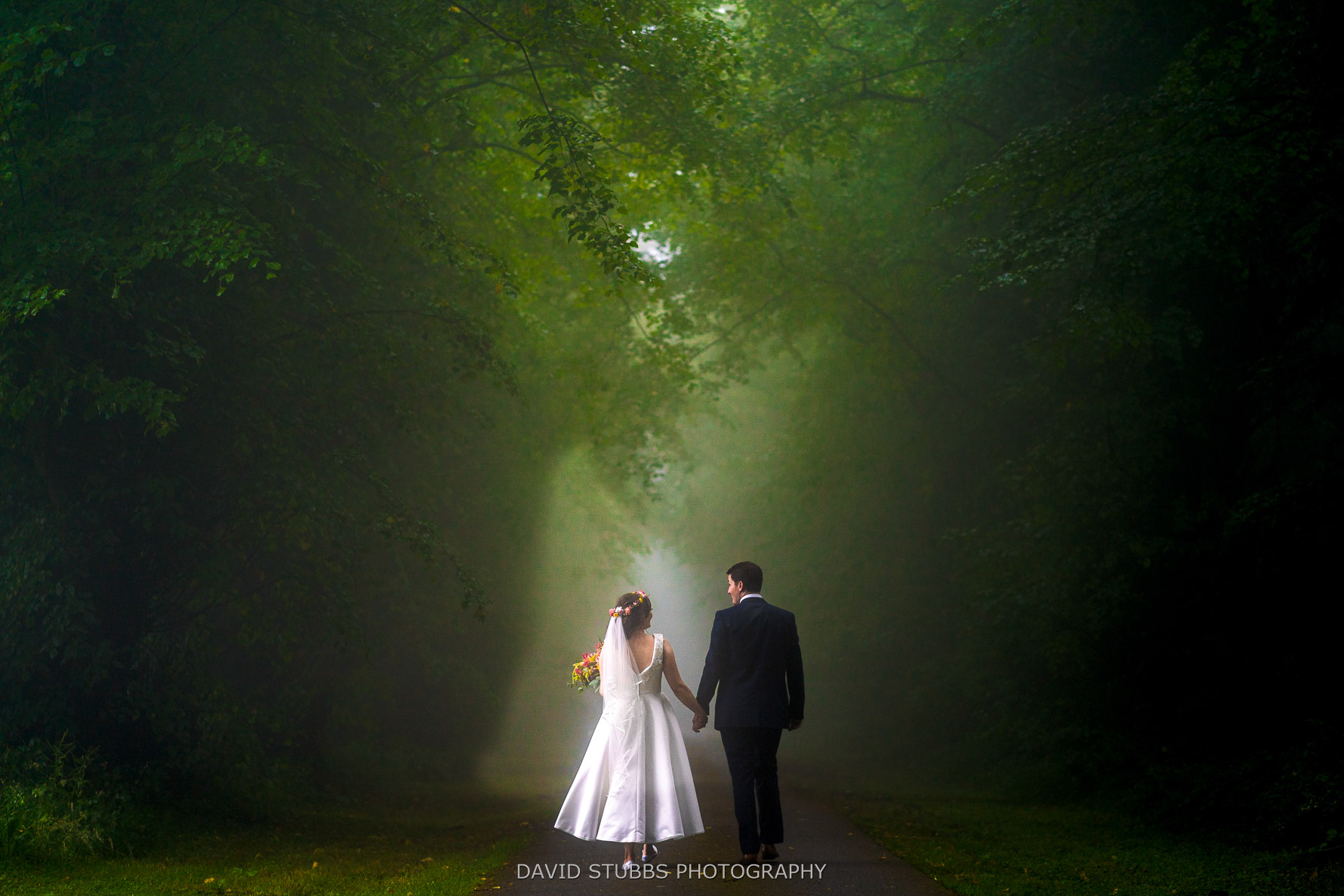 walking in fog for cors y gedol hall wedding photography