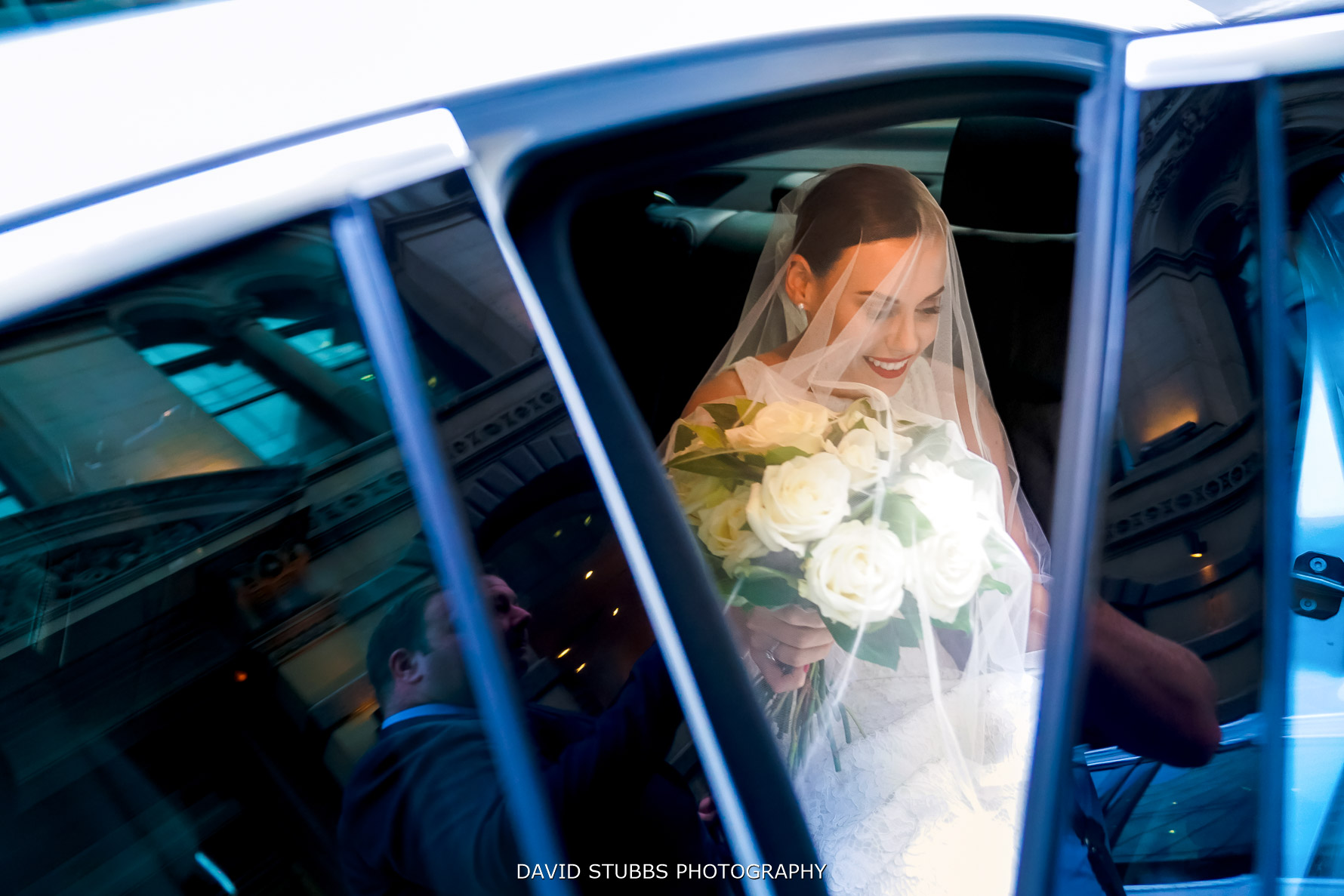 bride getting out the car before wedding