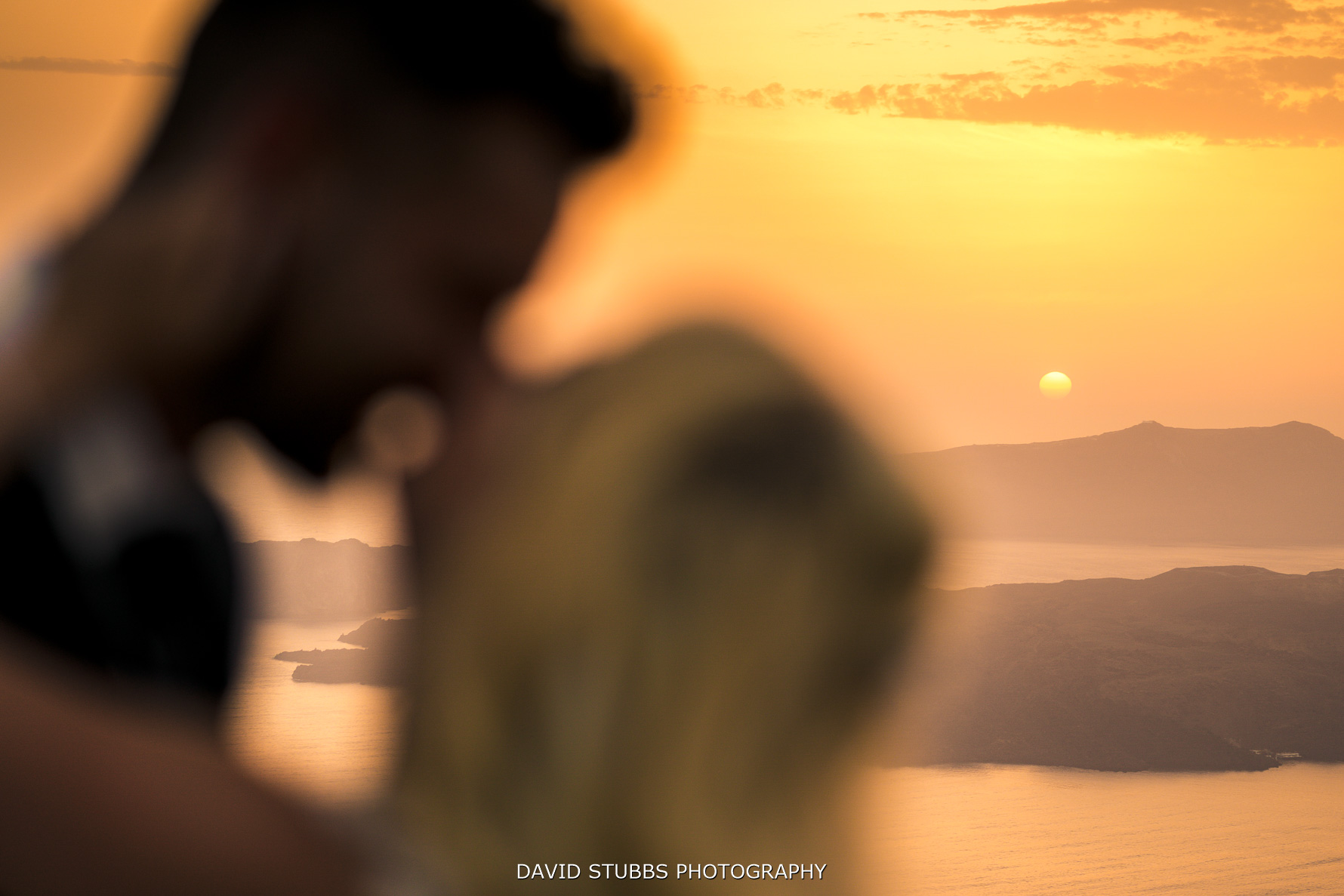 sun setting at Santorini wedding
