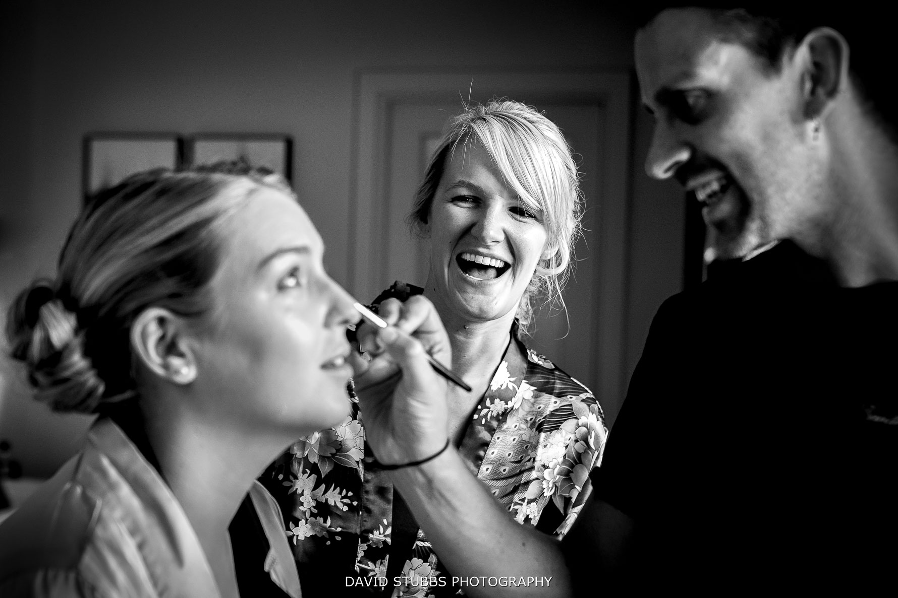 bride laughing for make up