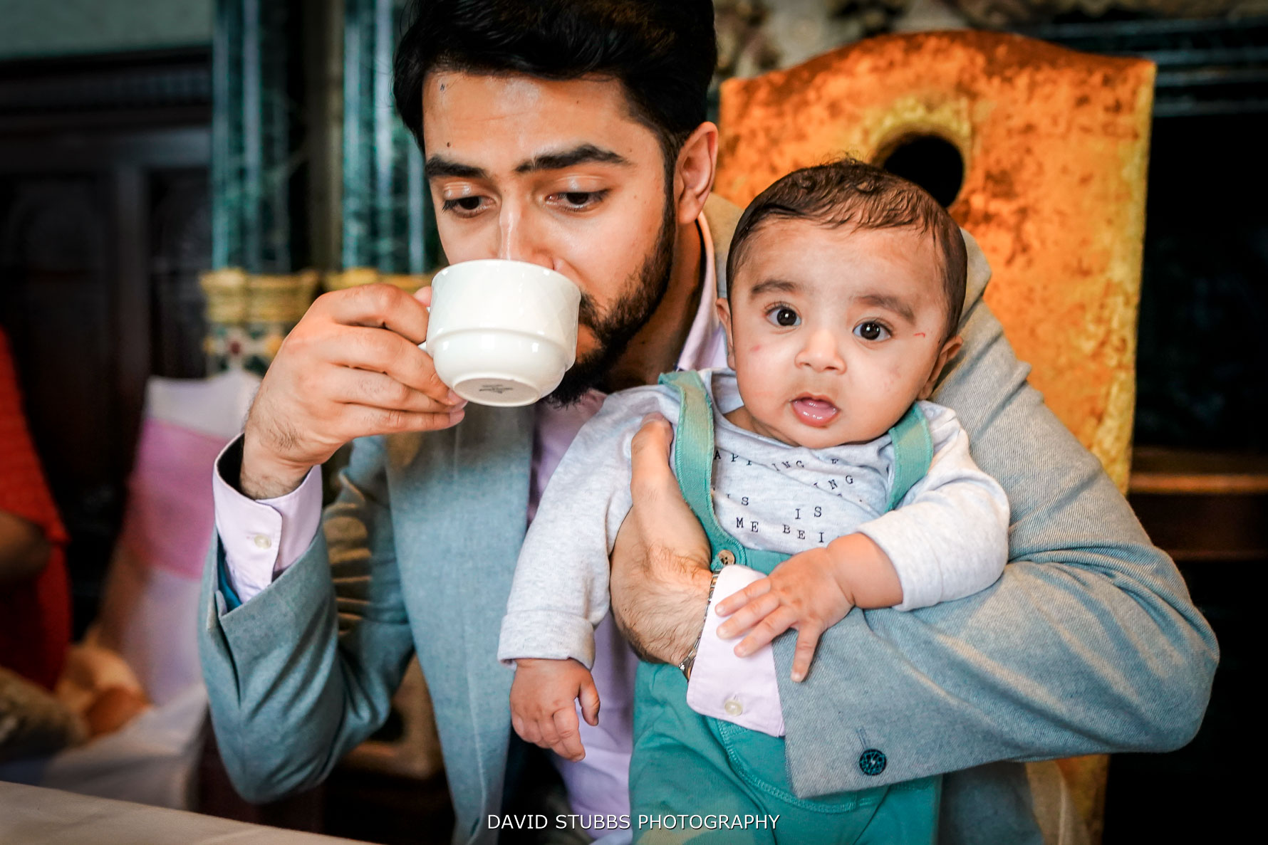afternoon tea at wedding holding baby