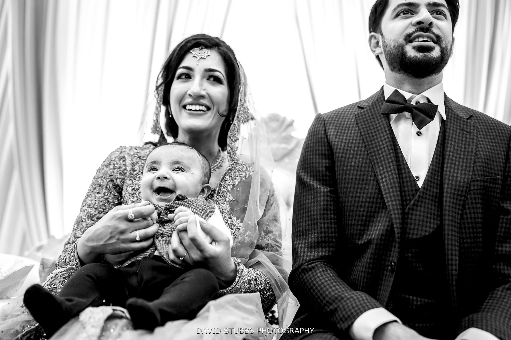 holding little one at reception