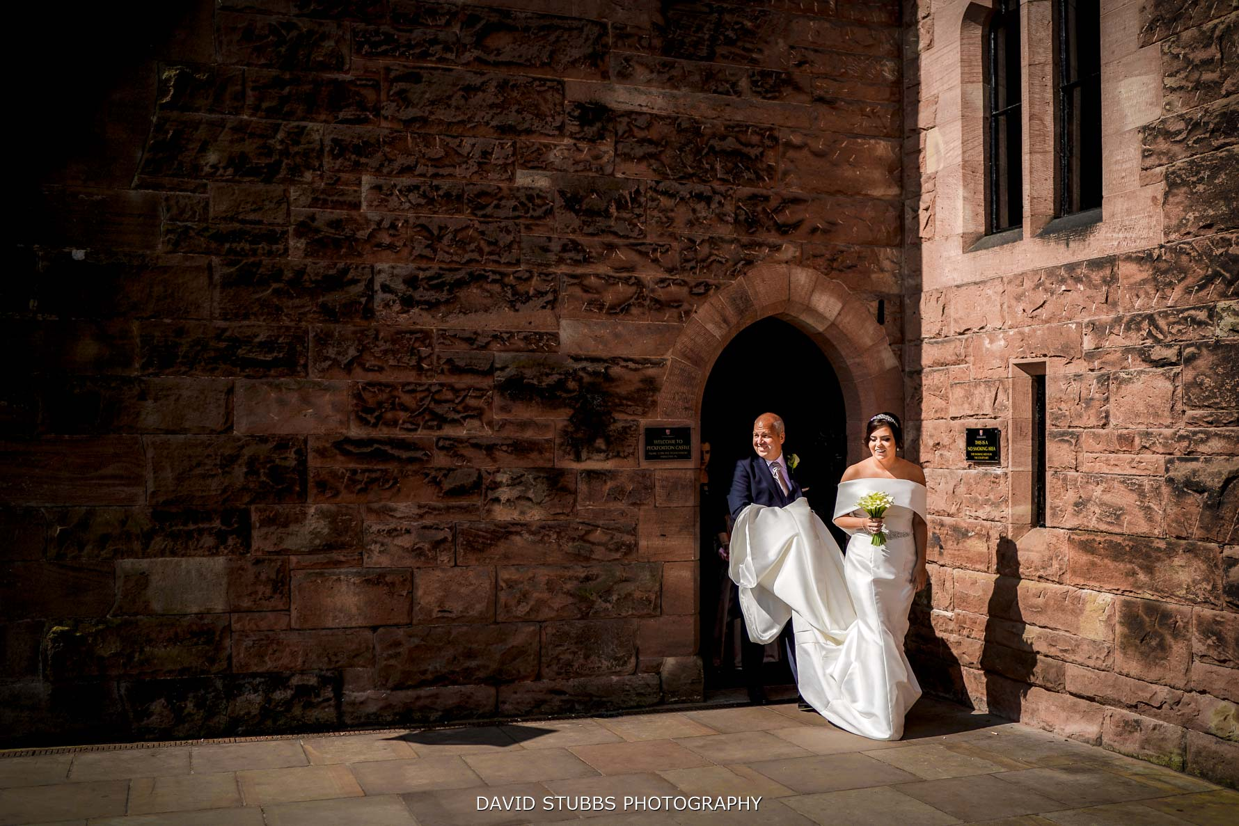 bride leaving the castle
