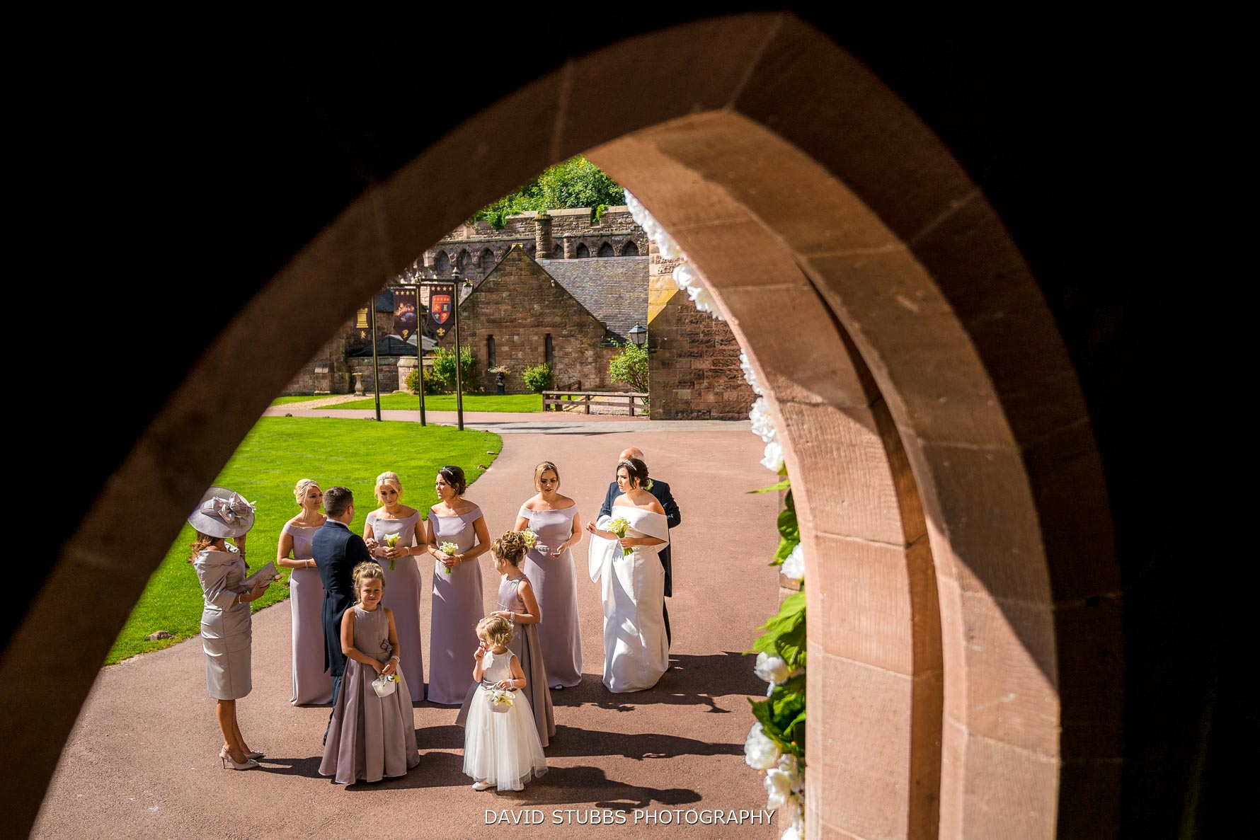 wedding party arriving together at peckforton castle