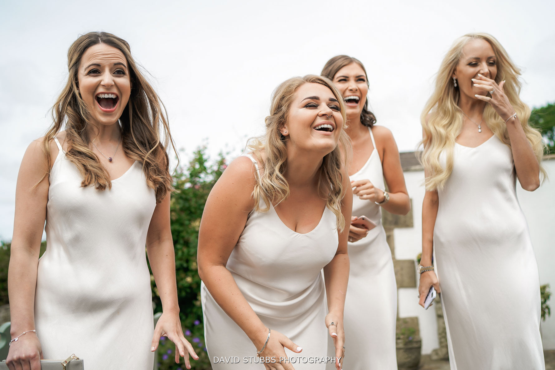 bridesmaids reaction to bride in her wedding dress
