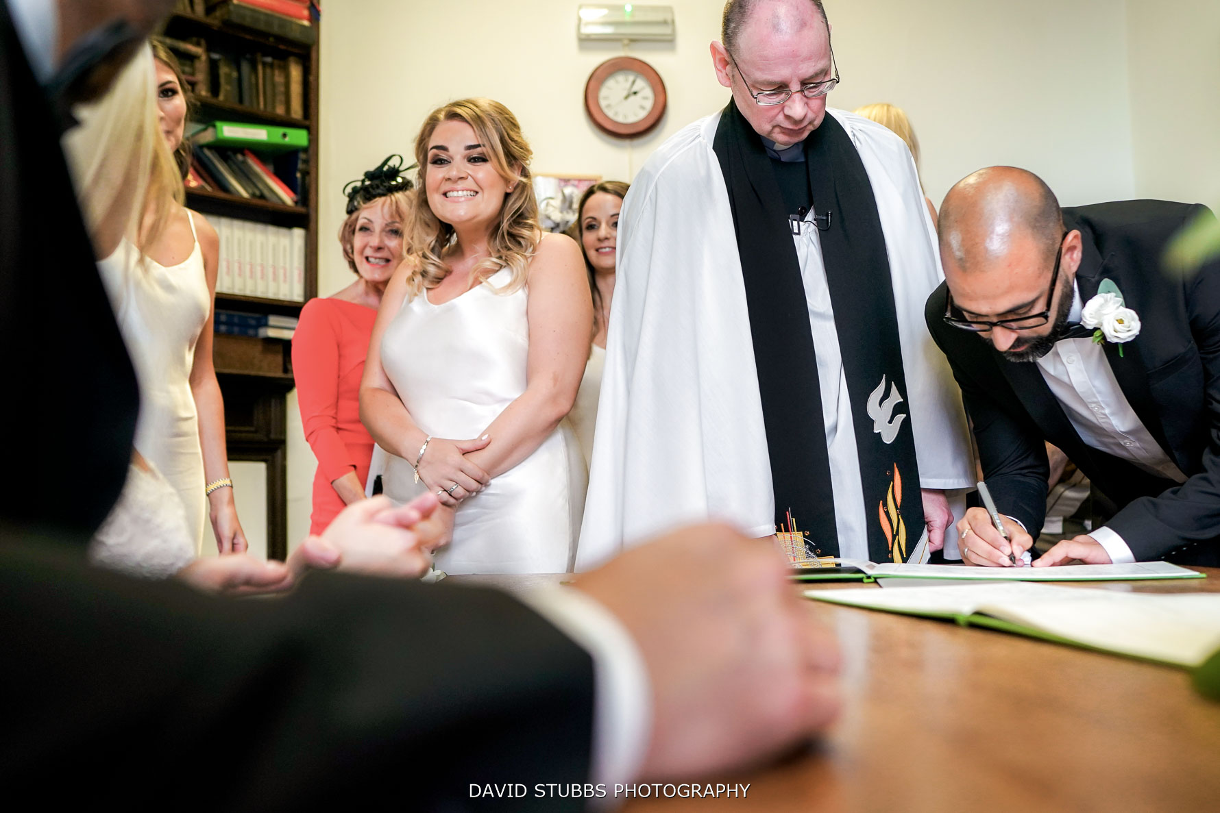 signing the register to confirm the marriage