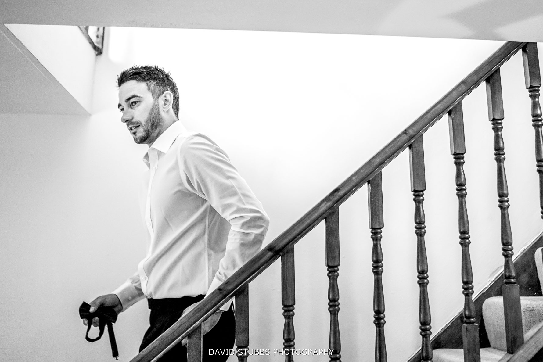 groom walking down the stairs nervously