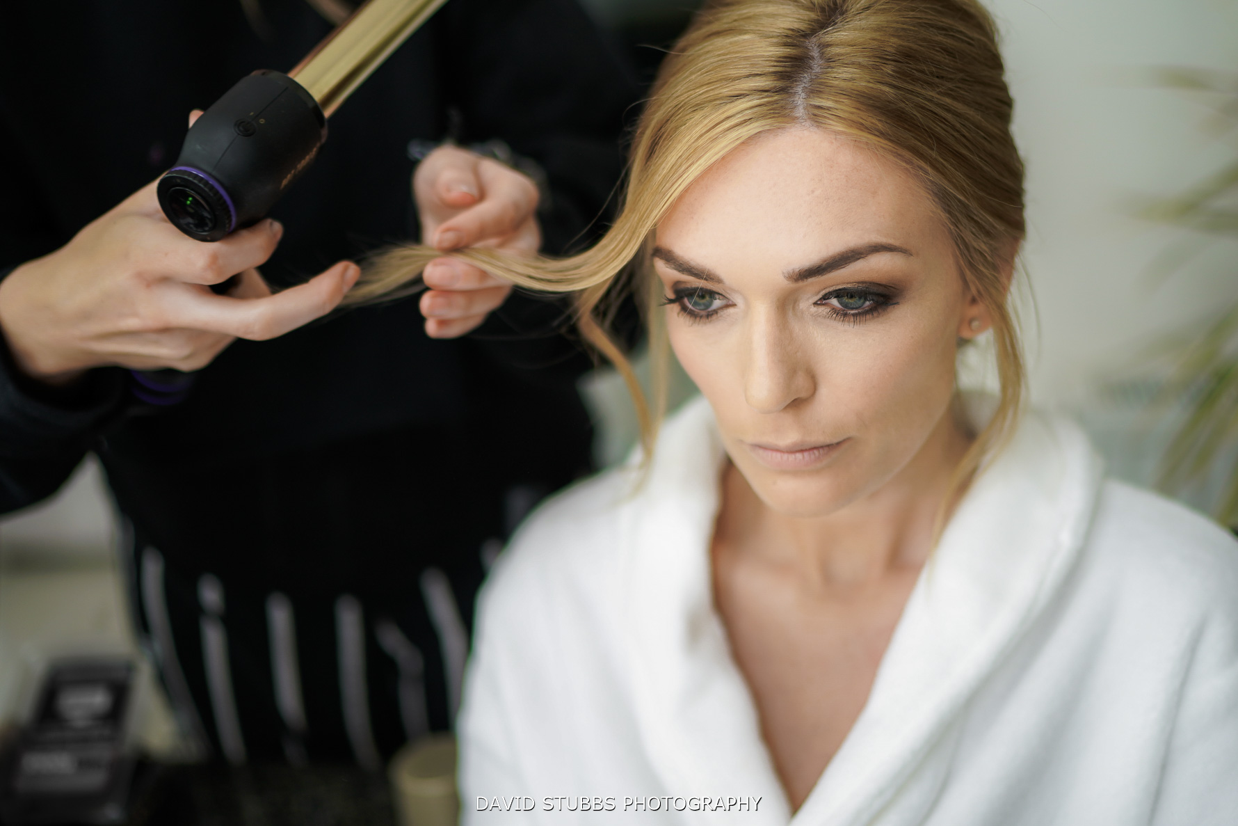 bride having hair and make up applied