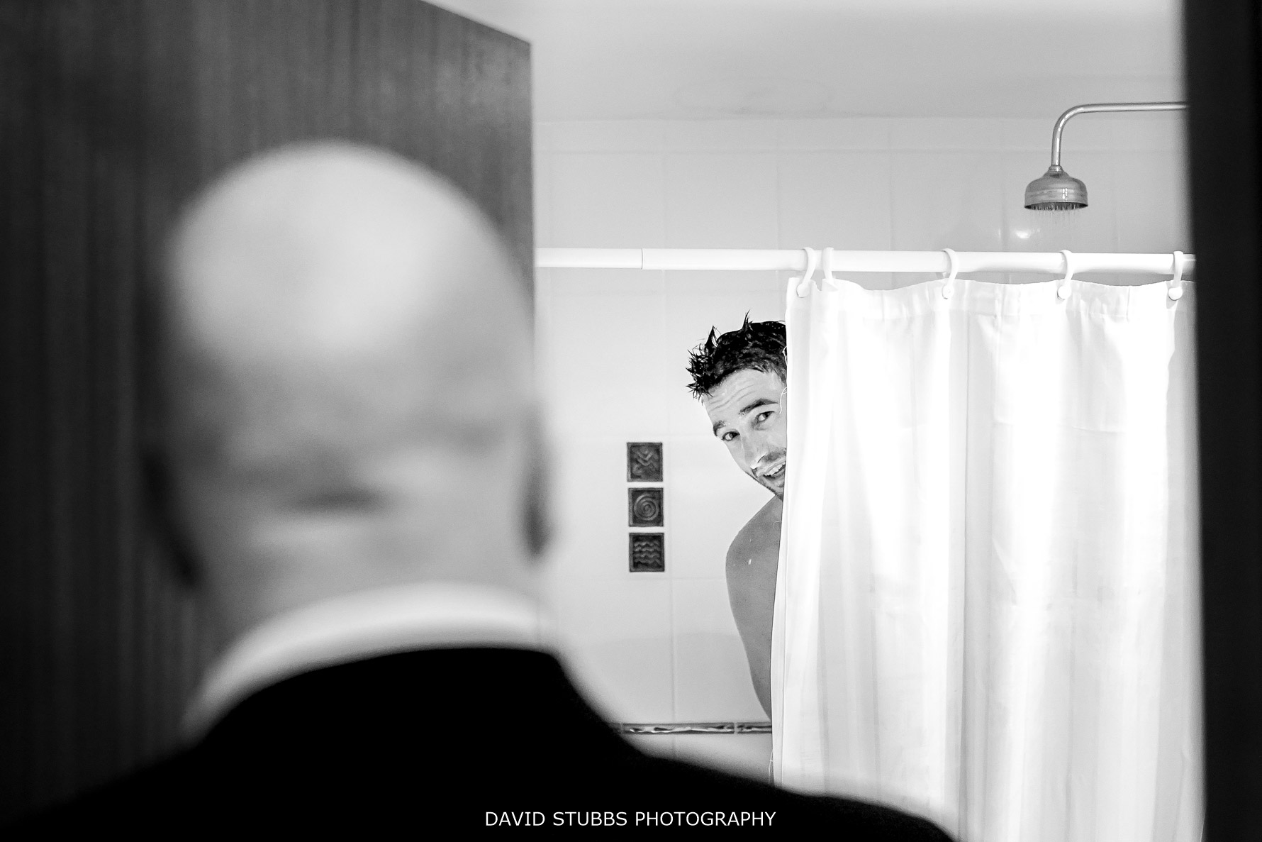 groom in the shower in black and white