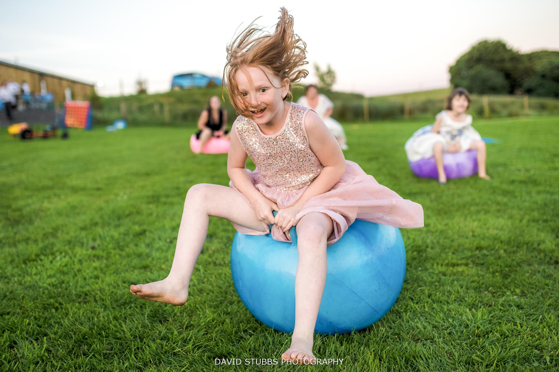 photo of flower girl on space hopper