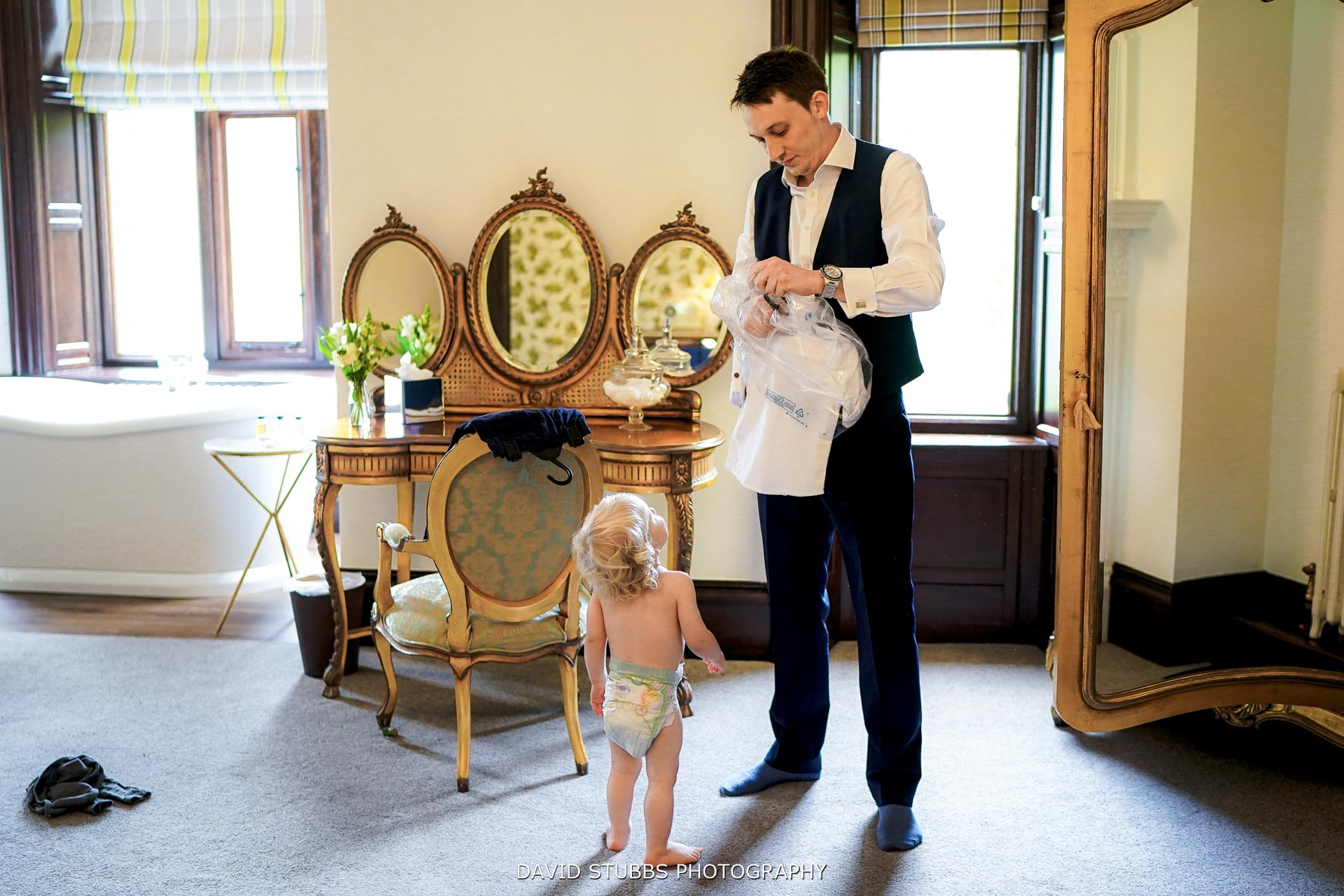 groom getting their son ready