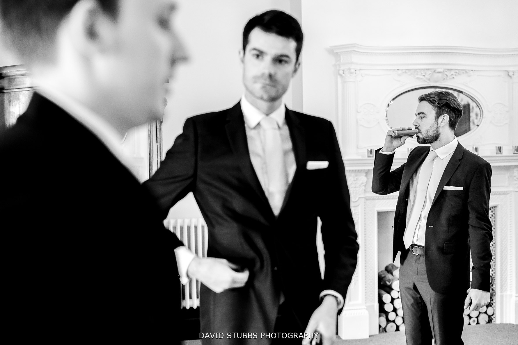 groomsmen enjoying a drink before the wedding ceremony