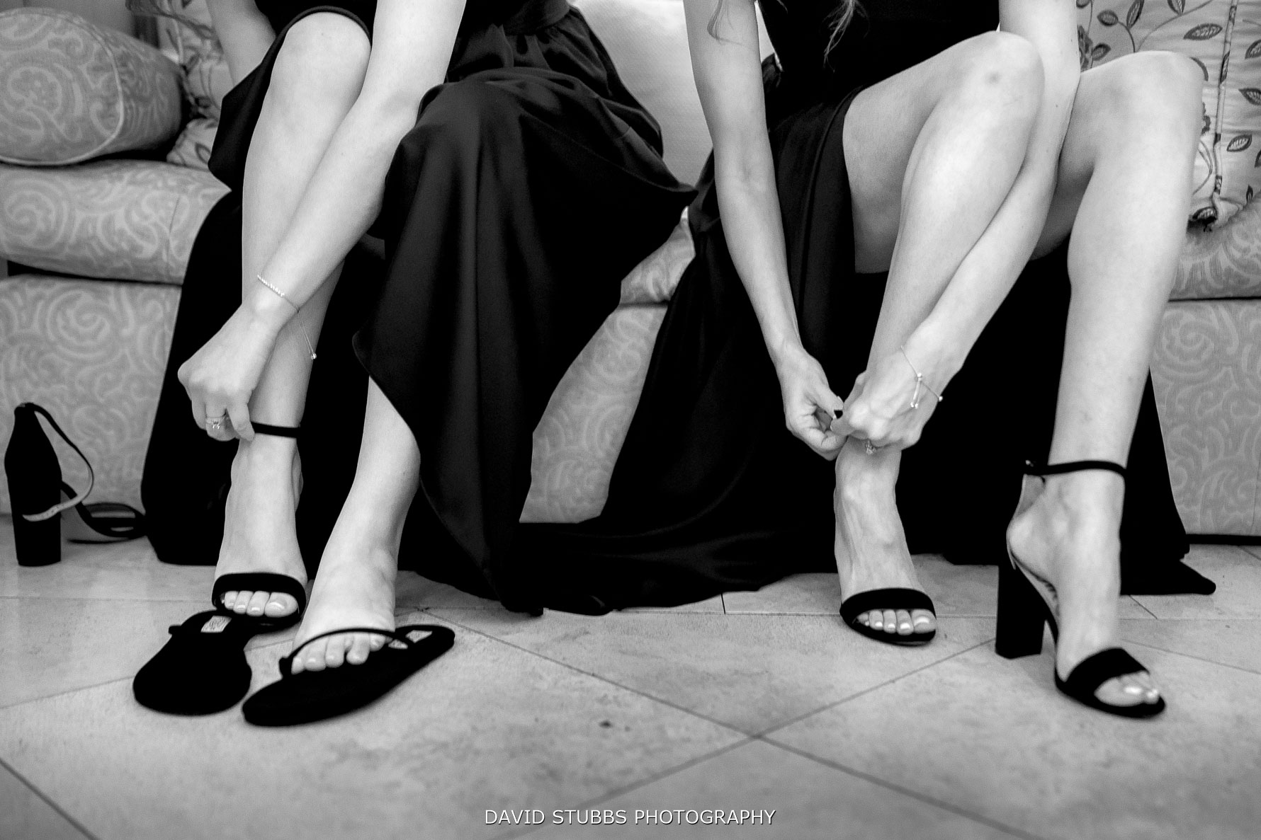 bridesmaids tying their wedding shoes up